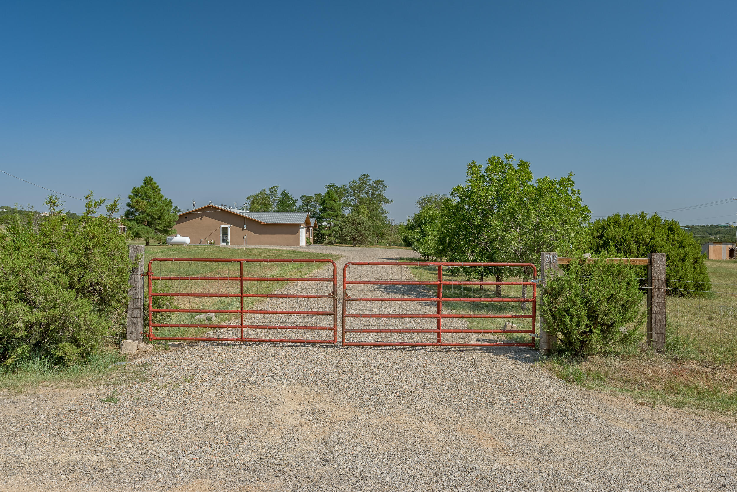 This Fabulous Home Sits On 2.4 Fully Fenced Acres And Is Absolutely Spotless And Move In Ready! Less Than 15 Minutes From Tramway And Central And Yet Country Living At Its Finest! This Home Has Been Completely Updated With All New Kitchen & Bathroom Cabinetry & Granite Counter Tops. New Tile, Carpet & Fresh Paint Throughout Entire Home. New Synthetic Stucco In 2020, Pella Windows In 2019, Owned Propane Tank, Refrigerated Air, Large Woodstove And Possible 4th Bedroom Or Office. Chicken Coop And Additional Sheds Fenced In And Ready For Potential Hobby Farm. This Property Has So Much To Offer. Don't Let This One Slip Away. Schedule Your Private Showing Today! This Is A Great Place To Call Home!