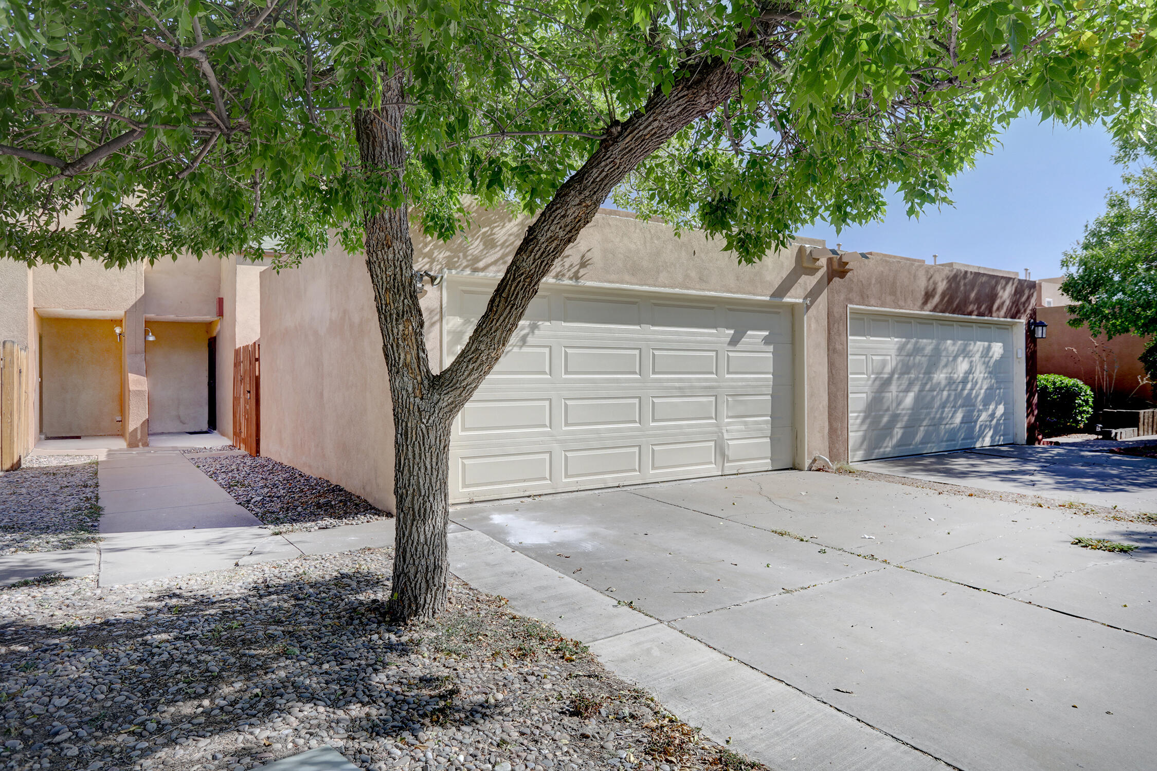 Near North Valley for under $200K!!!  This townhome offers a large backyard, two master suites, a wood burning fireplace, 2 car garage and a private courtyard!