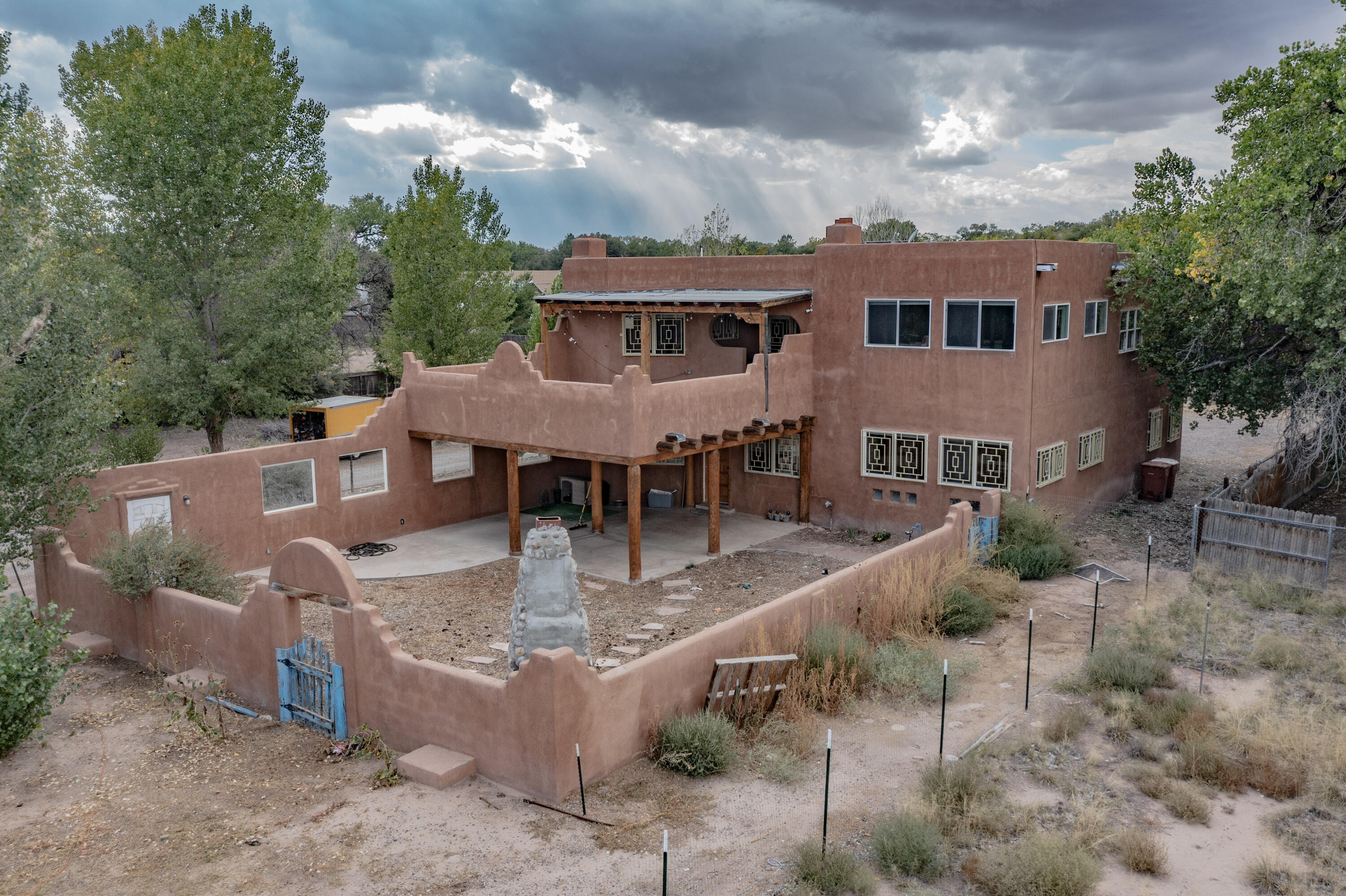 Custom built in 2007. Two Houses, EACH more than 4000 square feet, on 1.10 acres, in the Heart of the charming Village of Corrales. Live/Work, Live/Rent, Live/Extended or Multi-family. The Front House (3777) is eligible for Commercial, Residential or a combination application with 2 (bed)rooms and 1 bath downstairs, and 2 (bed)rooms and 1 bath upstairs. The Main House (3785), in back, has 4 bedrooms, 4 bathrooms, and multiple living spaces. Gorgeous views of the Sandia Mountains from inside, and outside on the Sunrise Deck. Party in the evening on the Sunset Deck. Why buy one when you can have two? Live in back and rent the front house, or use it as your law, medical, or other office, or retail space. Property is occupied. Drive down the road but please do not disturb the residents.