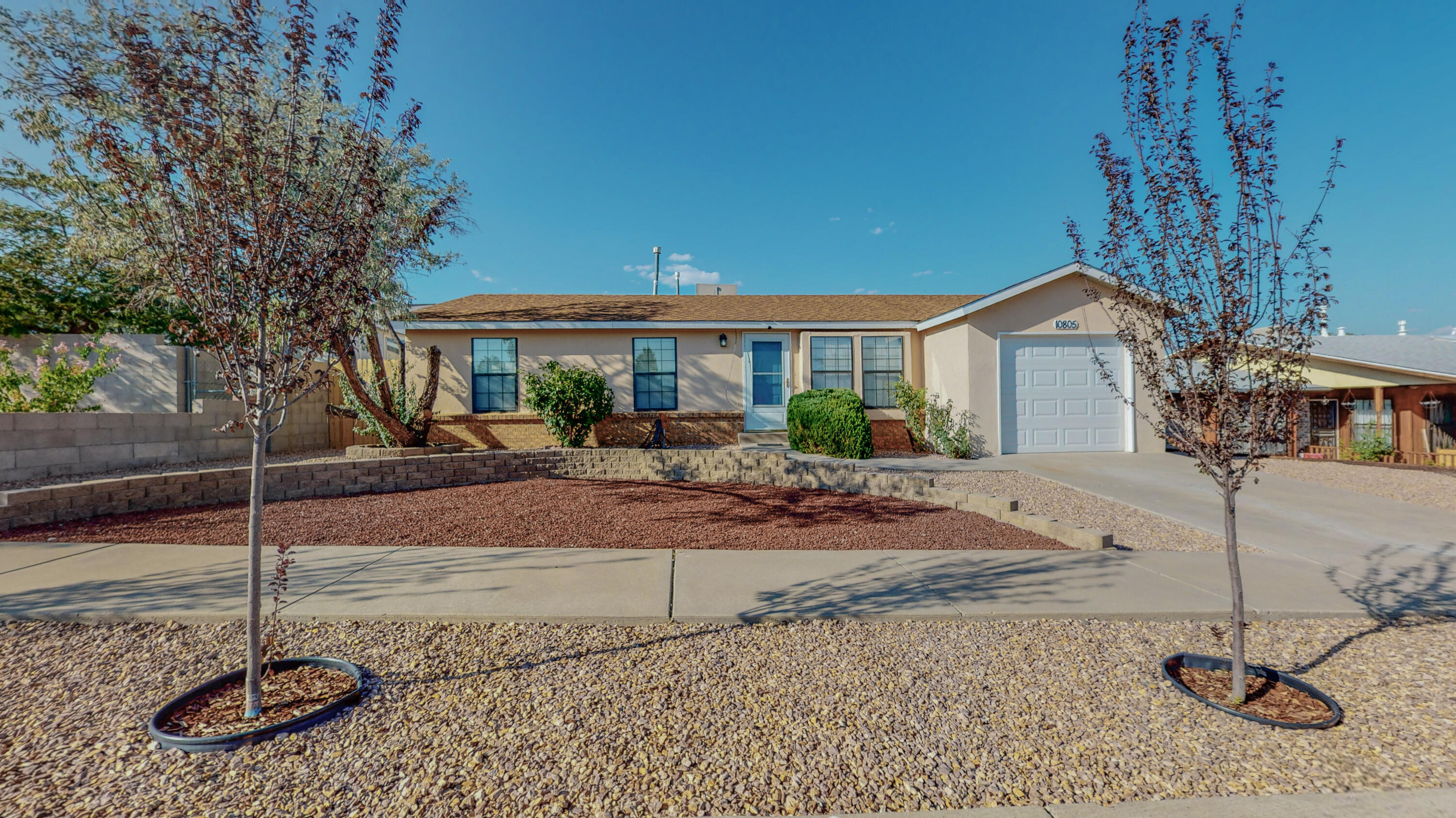 Welcome Home to this GEM in the beautiful Westgate Heights neighborhood! This home has been meticulously cared for! Beautifully landscaped and low maintenance front yard with backyard access. Some upgrades include New stucco, gutters and privacy trees planted in back, new washer and dryer, updated sinks in the bathrooms, newer heater and mastercool cooler, and newer doors on all the rooms. The kitchen catches the eye with the added granite countertops and beautiful large copper farm sink! The home has also been completely repiped and all poly piping has been removed! Close proximity to Westgate parks and schools! BEAUTIFUL HOME!!!
