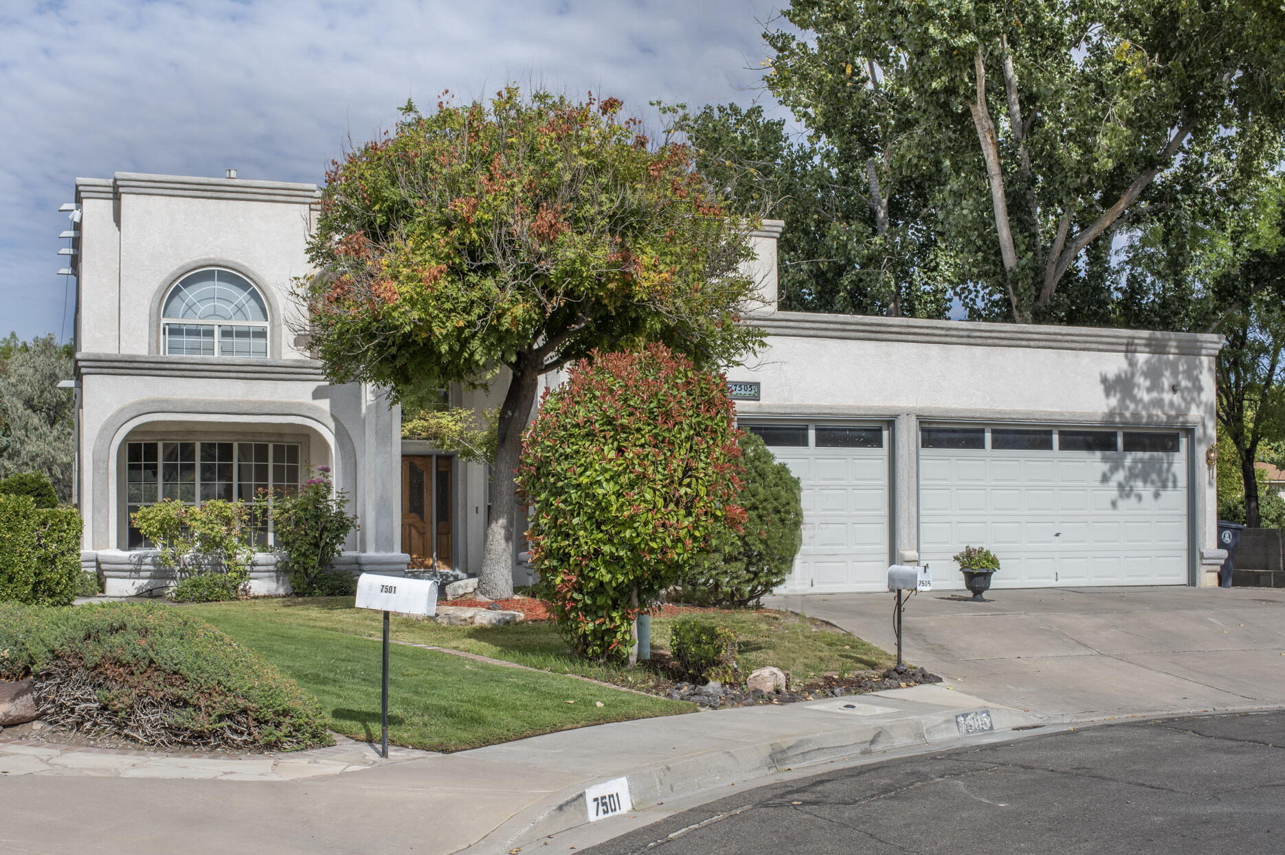 OPEN 10/17 SUNDAY 2:30-4:30 Graceful 2 story home w/multiple patios & gardens. This 4 bed / 3 bath home sits in a highly desired neighborhood between ABQ Academy & La Cueva High School. Convenient to shopping, restaurants, hiking in the Sandias, & other great Albuquerque attractions. Master bedroom (up) is expansive, but there is a guest bed/office with a bathrm on the main level as well. This home sports two living areas and a wide open, renovated kitchen that opens to the breakfast nook & family room.  Main floor is all hard surface flooring (no carpet). All appliances included. This yard has beautiful grass, cascading planters, 3 patios, gas hookup for grill, and a separate patio for a hot tub or private sitting area.  ASK ABOUT an available $3,700 seller credit to buyer at close!