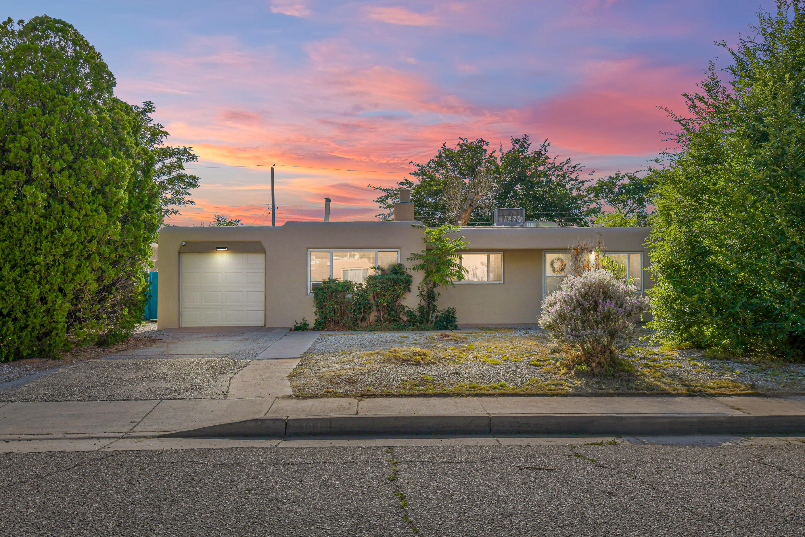 3 bed, 2 bath, 2 living areas, and beautiful kitchen. This charming little North East Heights home located near Uptown, KAFB, and Coronado center won't last long! Huge backyard with covered patio. Backyard needs some TLC. New HVAC and hot water heater unit added in 2019. Updated Stucco, laminate, and carpet.