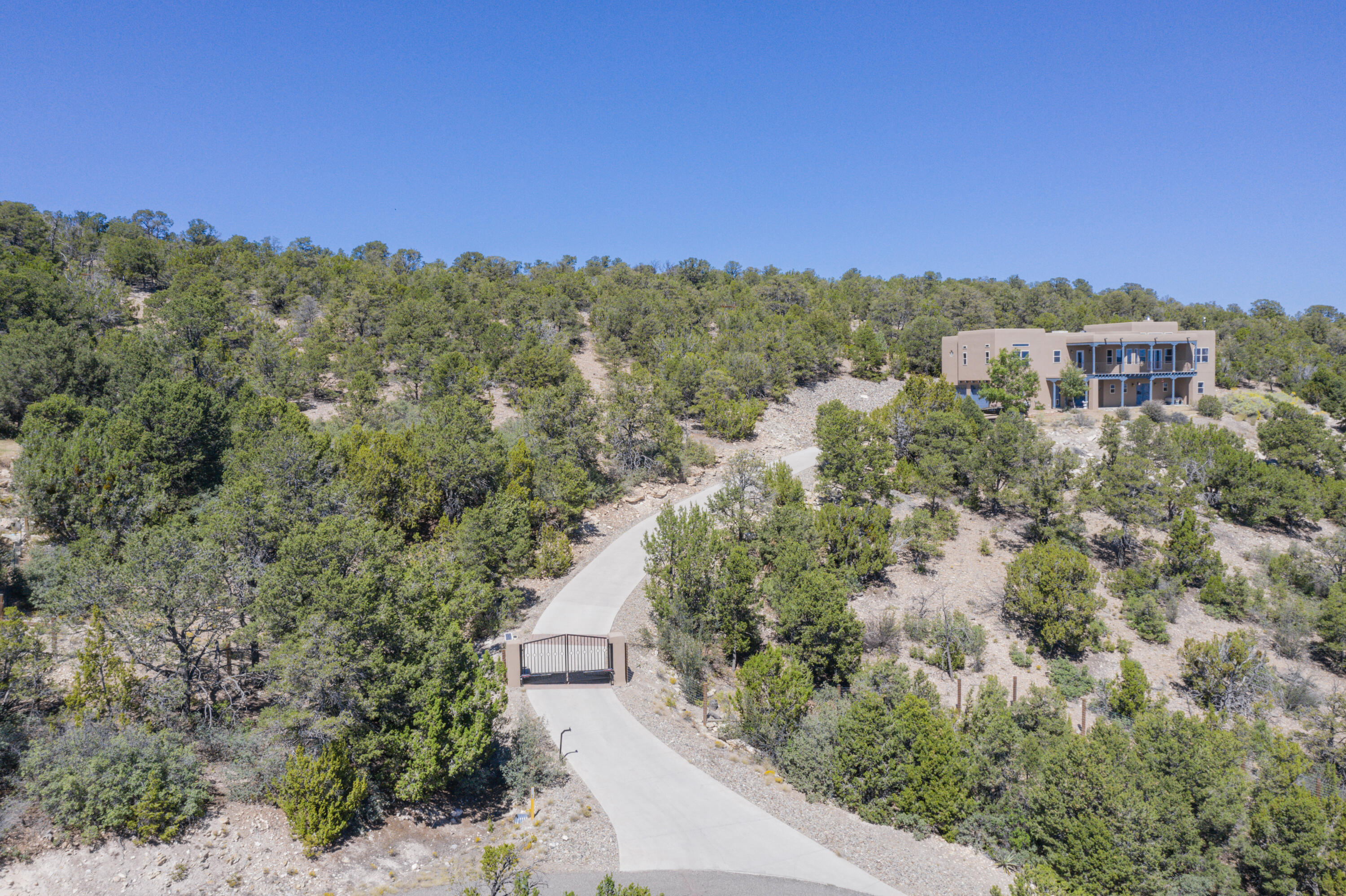 Stunning 4 bed, 4300 sqft home, nestled on over 5 acres of beautiful mountain land with exquisite views throughout! From the gourmet kitchen with granite countertops, custom dove-tailed cabinetry, high-end SS appliances, including a Wolf gas range and Dacor convection oven, and complete with 180 views from the breakfast nook which flows into the living room with custom gas fireplace and filled with light from the plethora of picture and clerestory windows. The master suite features a massive walk-in closet, jetted tub, and enormous separate shower and is on the opposite side of the home from the other three generous bedrooms, including one with custom Murphy bed. To say nothing of the 1500 sqft media/exercise/game room, elevator for easy 2nd floor access, and copious garage storage.