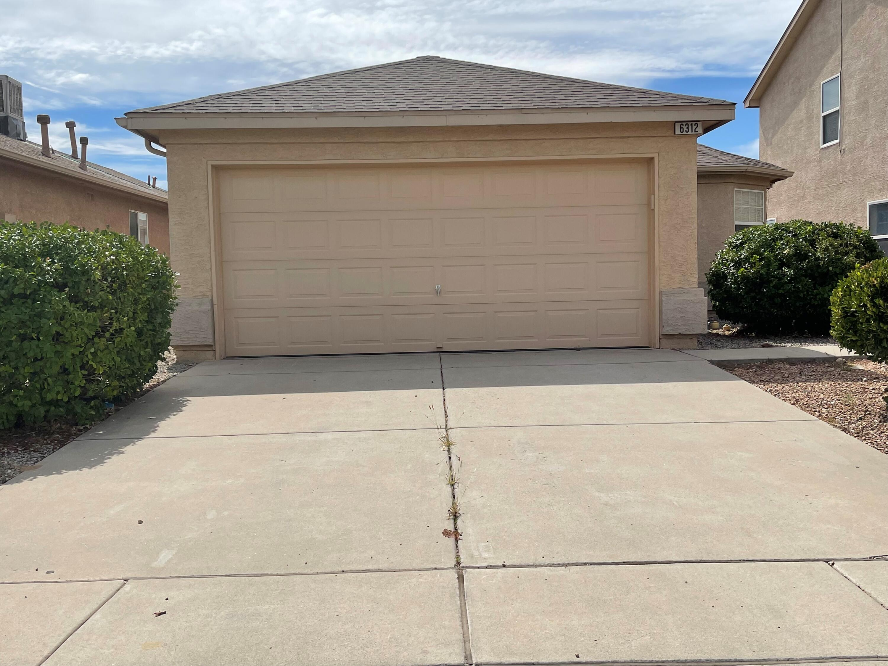This house in the private gated community of Vittoria is charming.  It has vaulted ceilings, newer counter tops in the kitchen and a beautiful view of the Sandias from the back yard. It is conveniently located to Paseo del Norte and Rust Hospital.All inspections have been completed. The roof is being replaced due to hail damage and the hot water heater will be replaced prior to closing.  With the right offer the seller is willing to give a credit of $700 for a new swamp cooler.