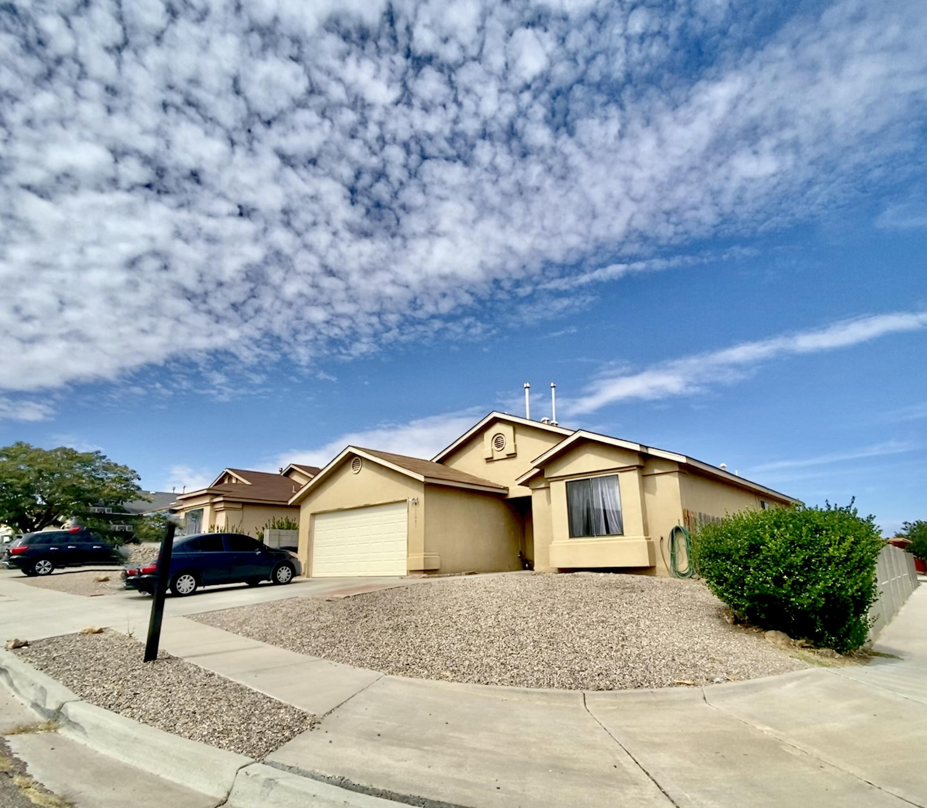 Beautiful well kept home with  4 Bedrooms - 2 baths - 2 car garage on a nice corner lot. Kitchen with plenty of cabinets, nice backsplash. big bright open living room with big windows! good size master bedroom with walk-in closet and separated from all other bedrooms with a full bathroom. all other rooms in good size, nice cover patio out in the backyard. Come see today!