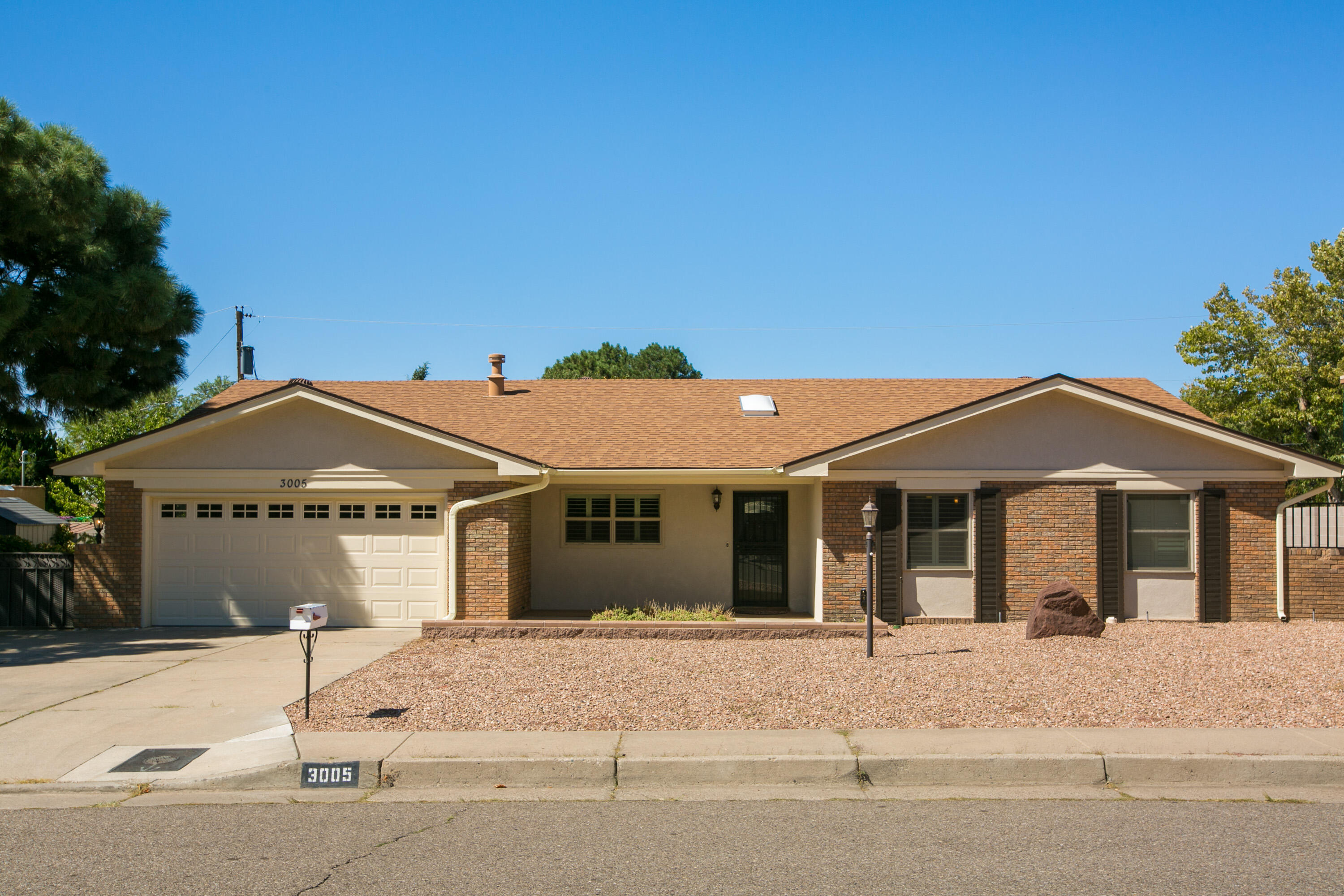 What a find!  Single level Mossman walking distance to Sandia High School with recent Furnace, REFRIGERATED AIR, and water heater.  Generous .24 acre lot with Side yard parking (RV)  and backyard access.    Beautiful engineered wood floors.   Nice floor plan with formal living and dining rooms plus den with gas log fireplace and built-in bookcases.   3 bedrooms and  some updates in bathrooms.  Plantation shutters.  Covered rear patio.   Detached Shed/workshop may have 220.  2 car attached garage with insulated door, newer opener, and storage closet.
