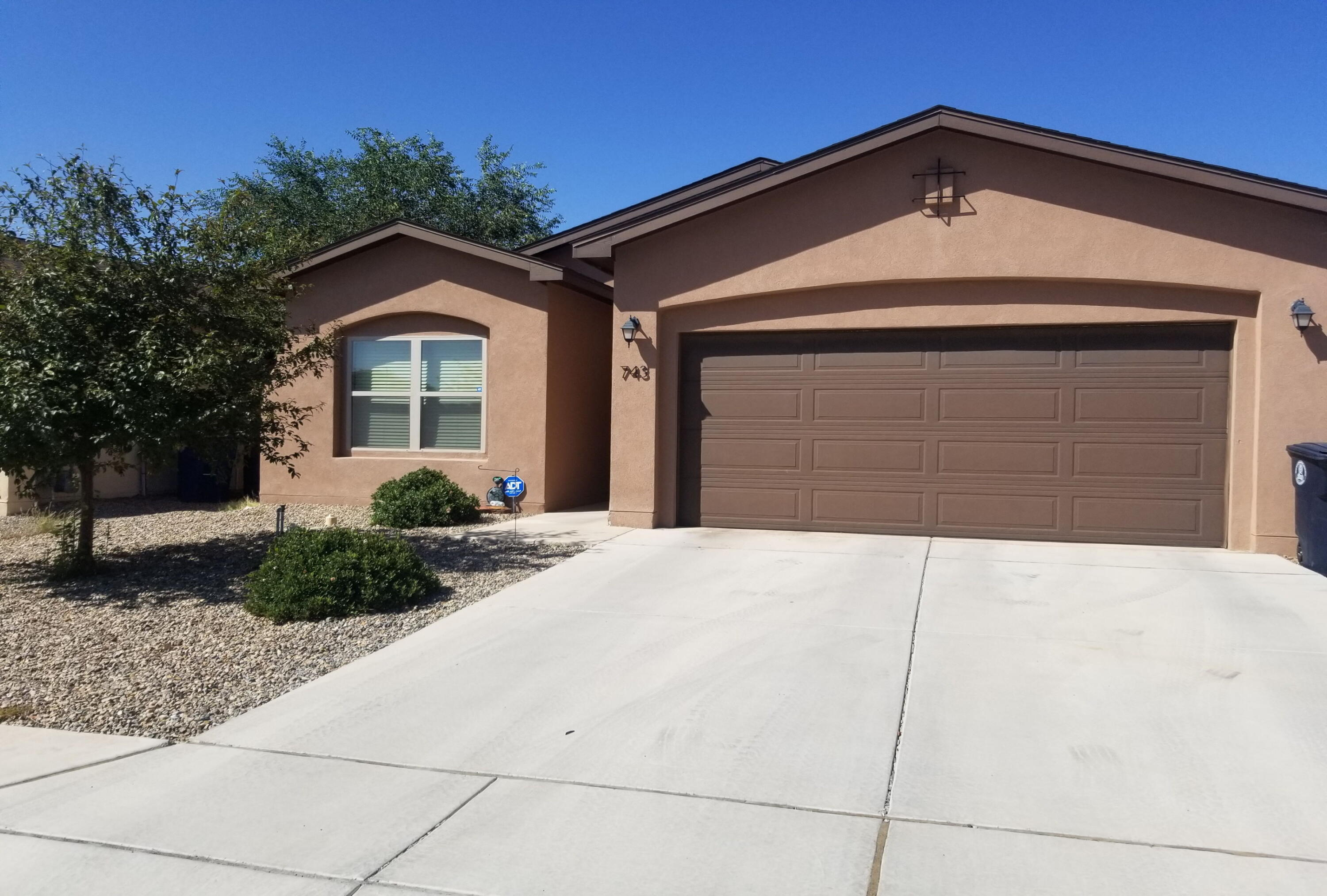 Here is an Abrazo Built Home!  This three-bedroom, two-bath has an open floor plan with high ceilings!  It sports upgraded tile and carpet flooring, stainless steel appliances, bright white quality interior door, contrasting quality paint throughout.  The oversize garage is is very accommodating for larger vehicles or a workshop area.  The backyard has xeriscaped and a nice covered patio with a natural gas stub!