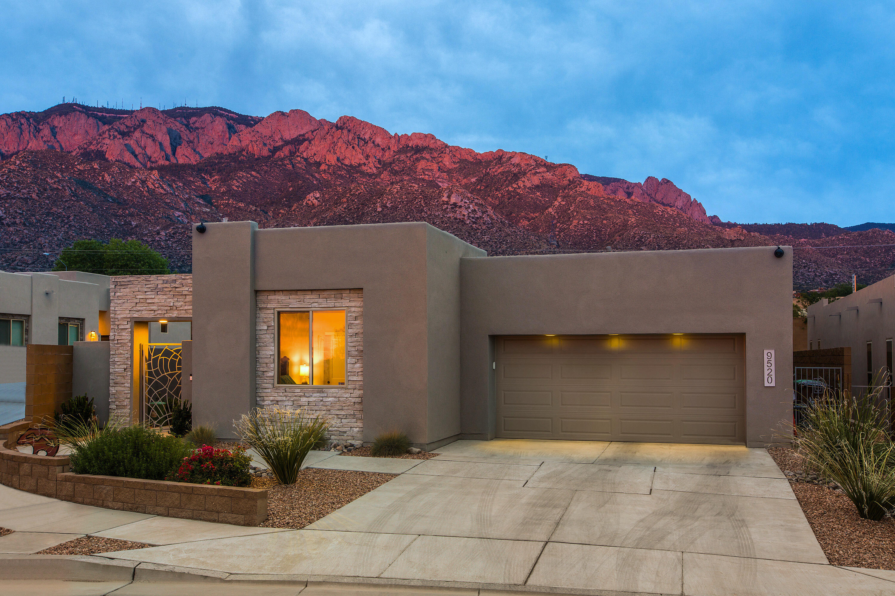 Stunning Contemporary Home by Scott Patrick. Architecturally appealing design from start to finish. Open Living, Dining and Kitchen arranged to take full advantage of the magnificent views of Sandia Crest. Indoor/Outdoor living with beautiful landscaping to take advantage of the awesome ABQ weather. Entertaining made easy with the flow of the kitchen, the island and the butler's pantry. Quartz Counters, Stainless Steel Appliances, 42'' cabinets and generous storage. 4 bedrooms, 2.5 baths, 2+ car garage. The Owners Suite offers a separate vessel tub and shower, walk in closet and mountain views.  14 panels of Owned Solar will keep your electric bills at a minimum.  Tray ceilings, fans, custom LED lighting, full home water filter and many more features to discover with your visit.