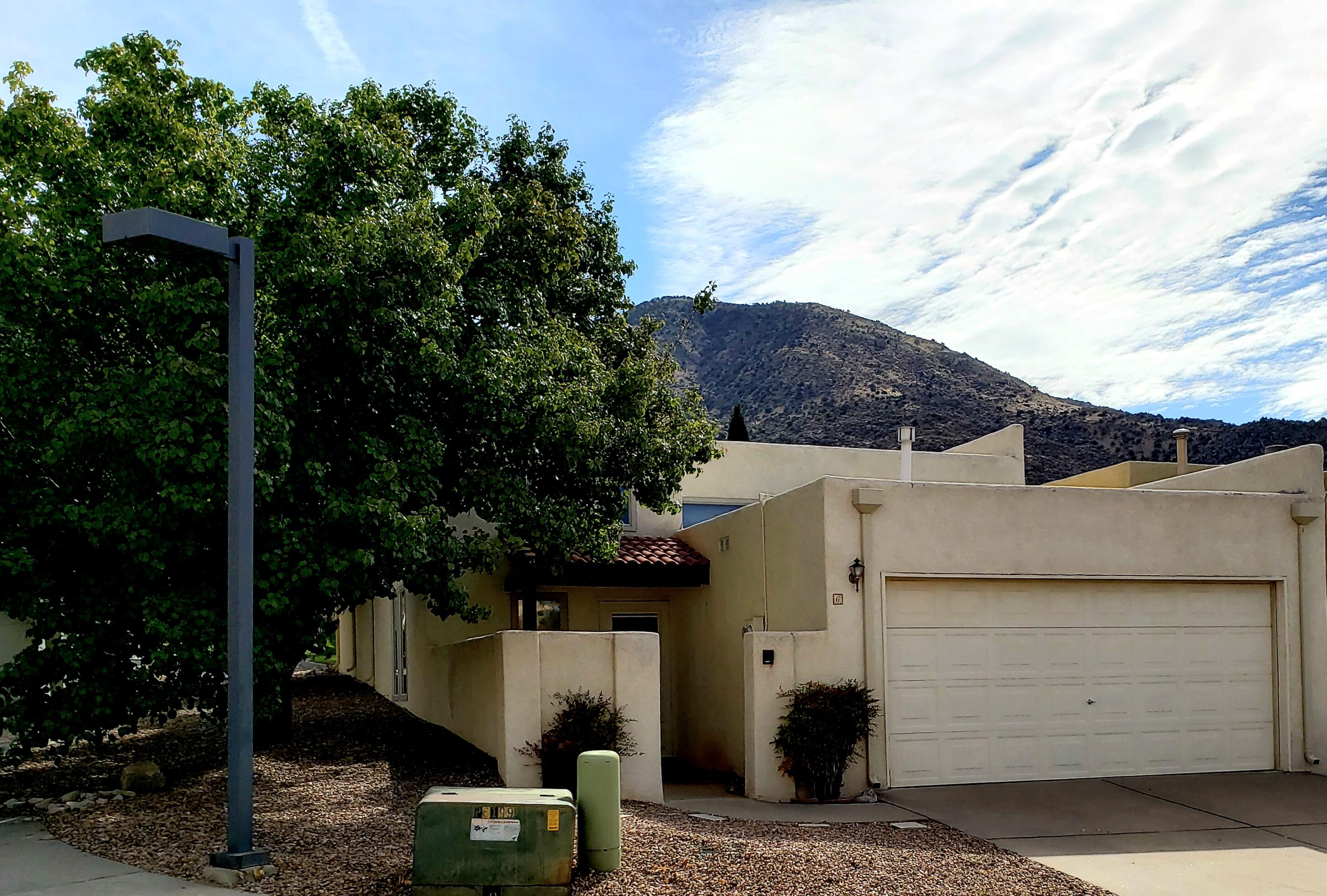 Move in ready adorable townhouse tucked into the foothills.