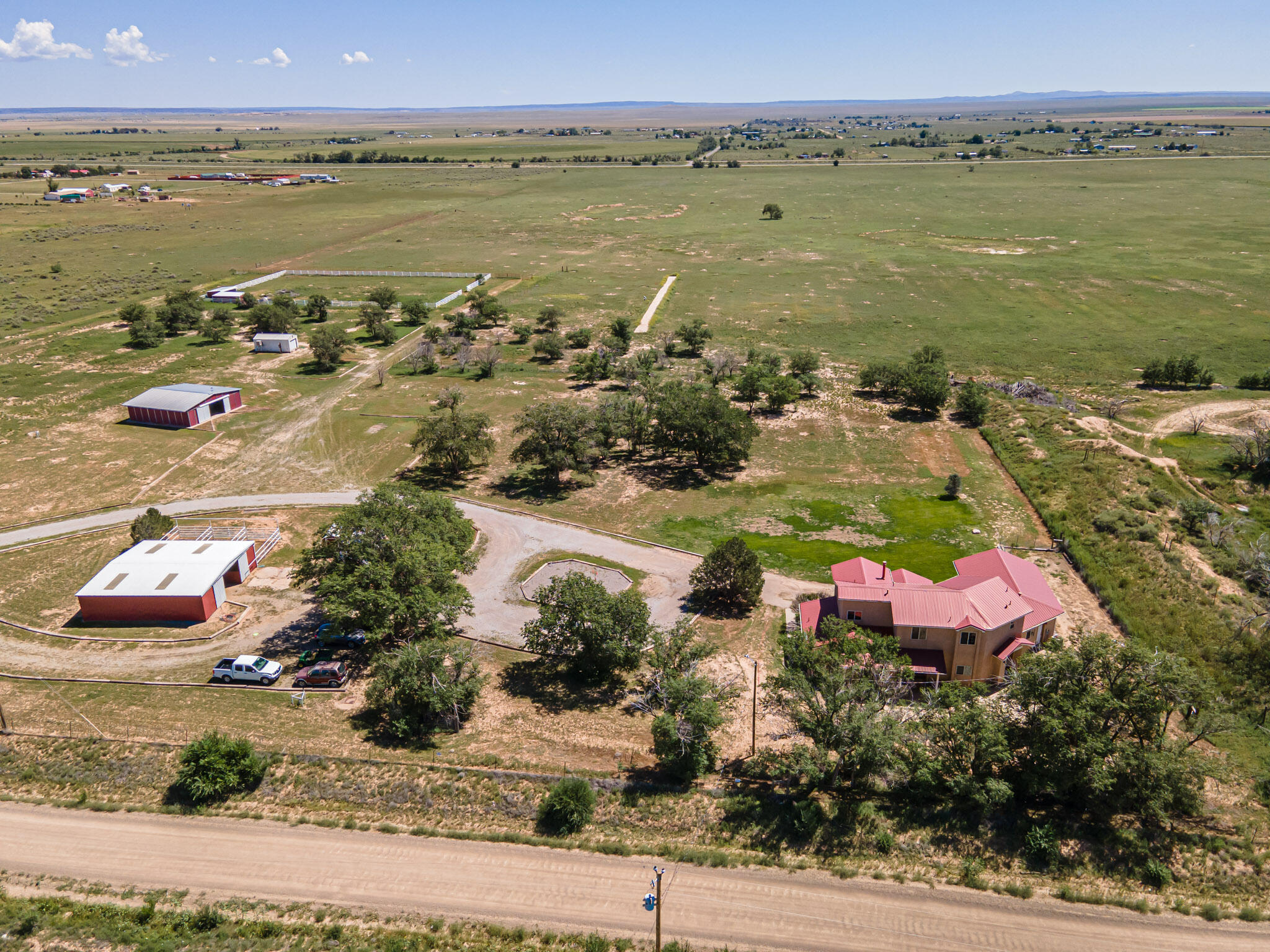 This deluxe horse property with Manzano Mountain views near Moriarty, New Mexico has it all - 50.72 acres with 114.3 acre feet of irrigated licensed water rights. Grow your own feed or set it up for irrigated permanent pasture. 3-phase power has been run, but is not fully connected. There are two good wells, irrigation and domestic. Both wells produce good high quality water. In fact, the water is so good that the water building has equipment for processing and bottling water and could support a related business. The horse facilities consist of a 3-stall barn, a 4-stall barn and a beautiful arena with 4 loafing sheds. The property is fully fenced and x-fenced, has mature trees and a lovely 2945 square foot 4-bedroom, 4-bath home. See additional information in the DOCUMENTS tab. Wow - what