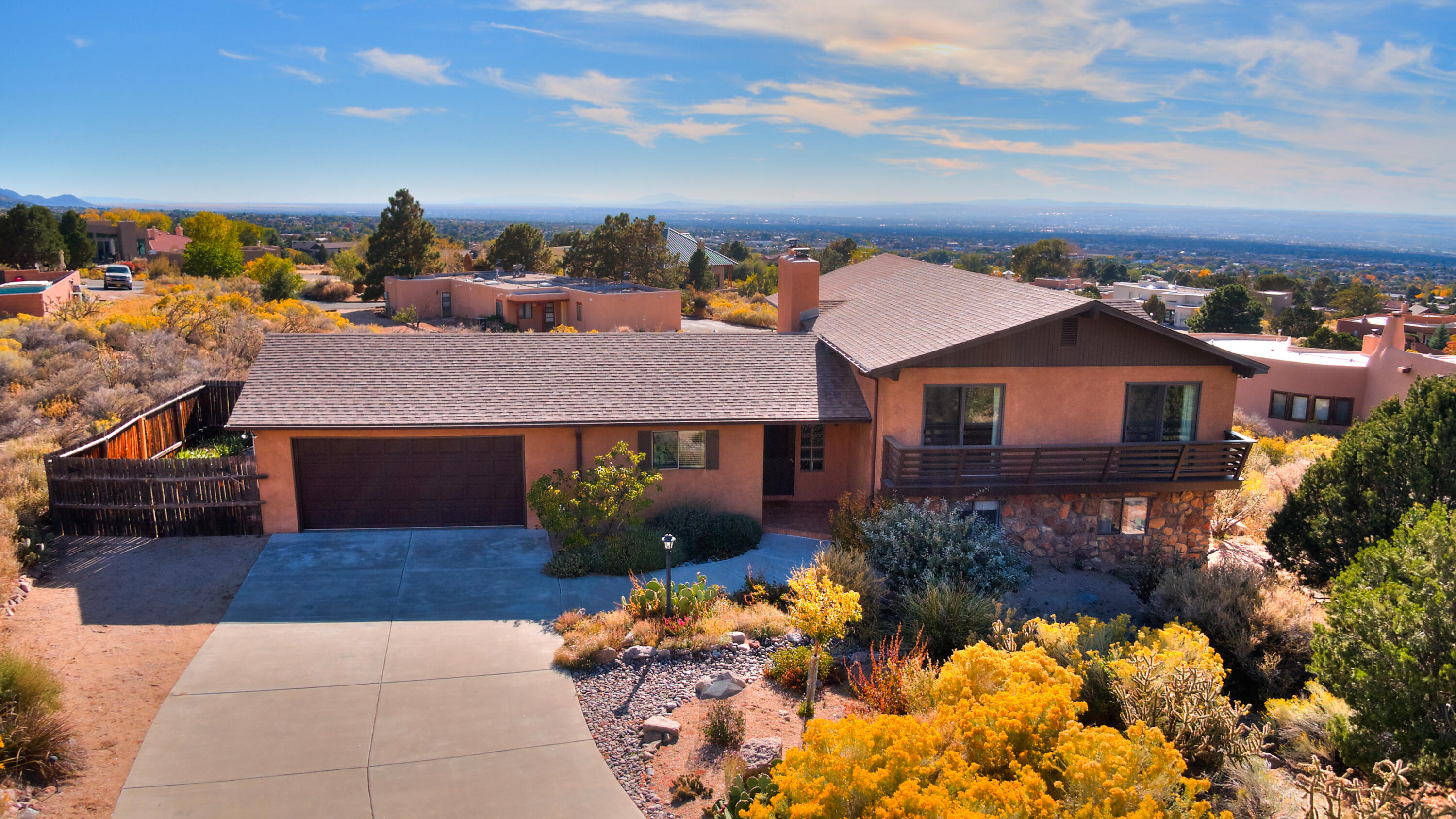 Luscious Location - Dramatically situated at the base of the Sandias, just two blocks to the National Forest and all it has to offer. Outstanding vistas from mountains to the Rio Grande Valley in all directions with exceptional natural light. Huge Prideof Ownership over the past 33 plus years - same owner proud! Continual upgrades/updates made throughout! Huge versatility in floor plan with room to roam plus multi use functionality. Multiple living and dining areas, inviting kitchen open to Family Room combo, bedroom/office with optional Murphy bed and more. The outdoor living includes two covered patios, covered view deck and view balcony - all framing wonderful views.
