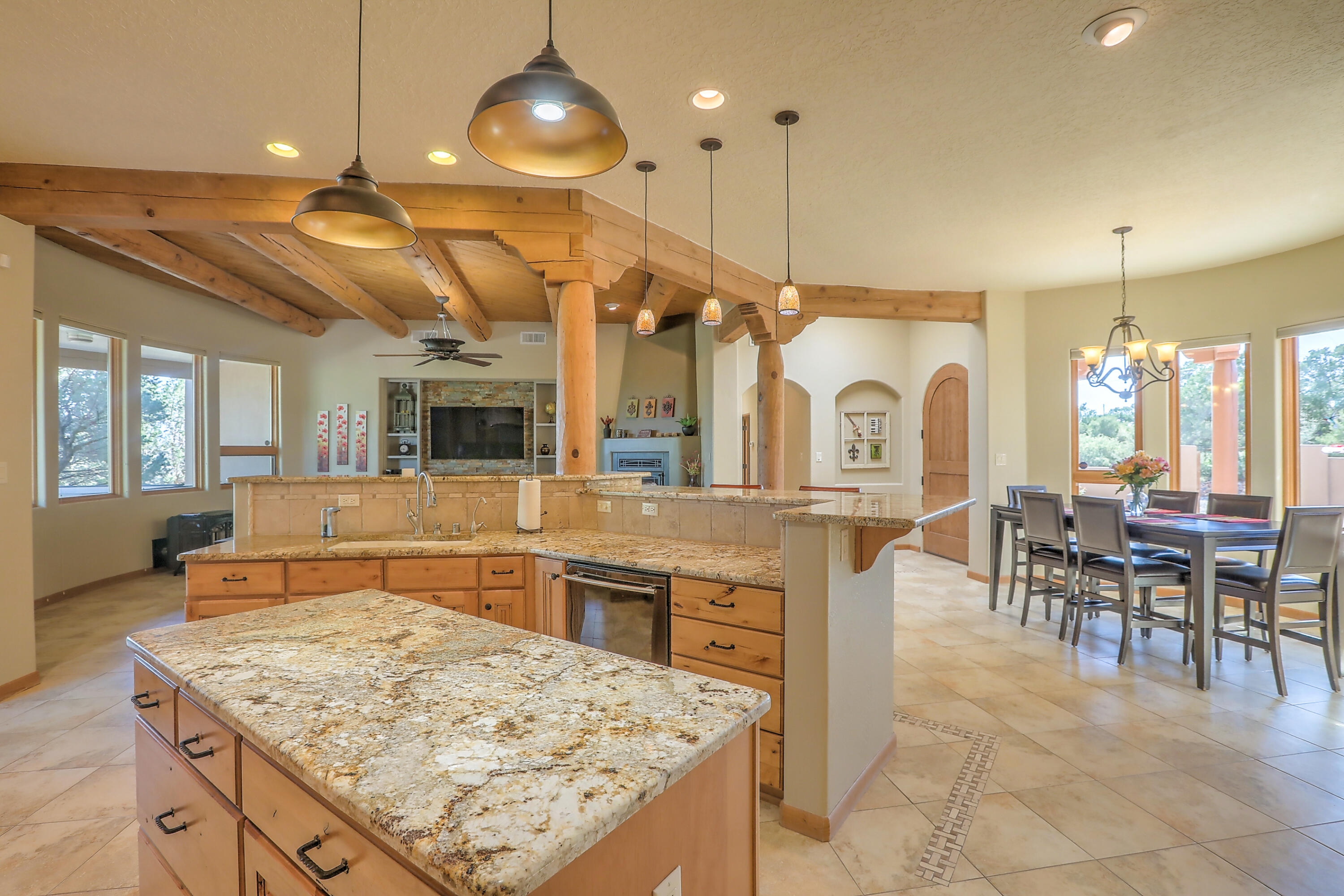 Secluded, private, custom mountain home, on a fully fenced 2.19-acre wooded lot w/2476 sqft on the main level, 527 sqft upstairs, refrigerated air, gorgeous curved walls w/Marvin wood windows, great room w/T&G beamed ceiling, stone accents, kiva fireplace, fabulous kitchen w/bar seating, alder cabinetry & granite countertops, 3 bedrooms down (2 ensuite) 2 flex rooms up (office, game room, studio) & an awesome wrap around covered deck w/breathtaking views for miles! Luxurious Owners retreat w/soaking tub, dual vanities, 2-way fireplace & private patio! Incredible, tranquil outdoor living w/over 1100 sqft of covered patio space, hot tub, fire pit, raised garden, grass, dog kennel & an 1828 sqft 4 car garage! It's the perfect fit for a live, work, play lifestyle & it could be your dream home!