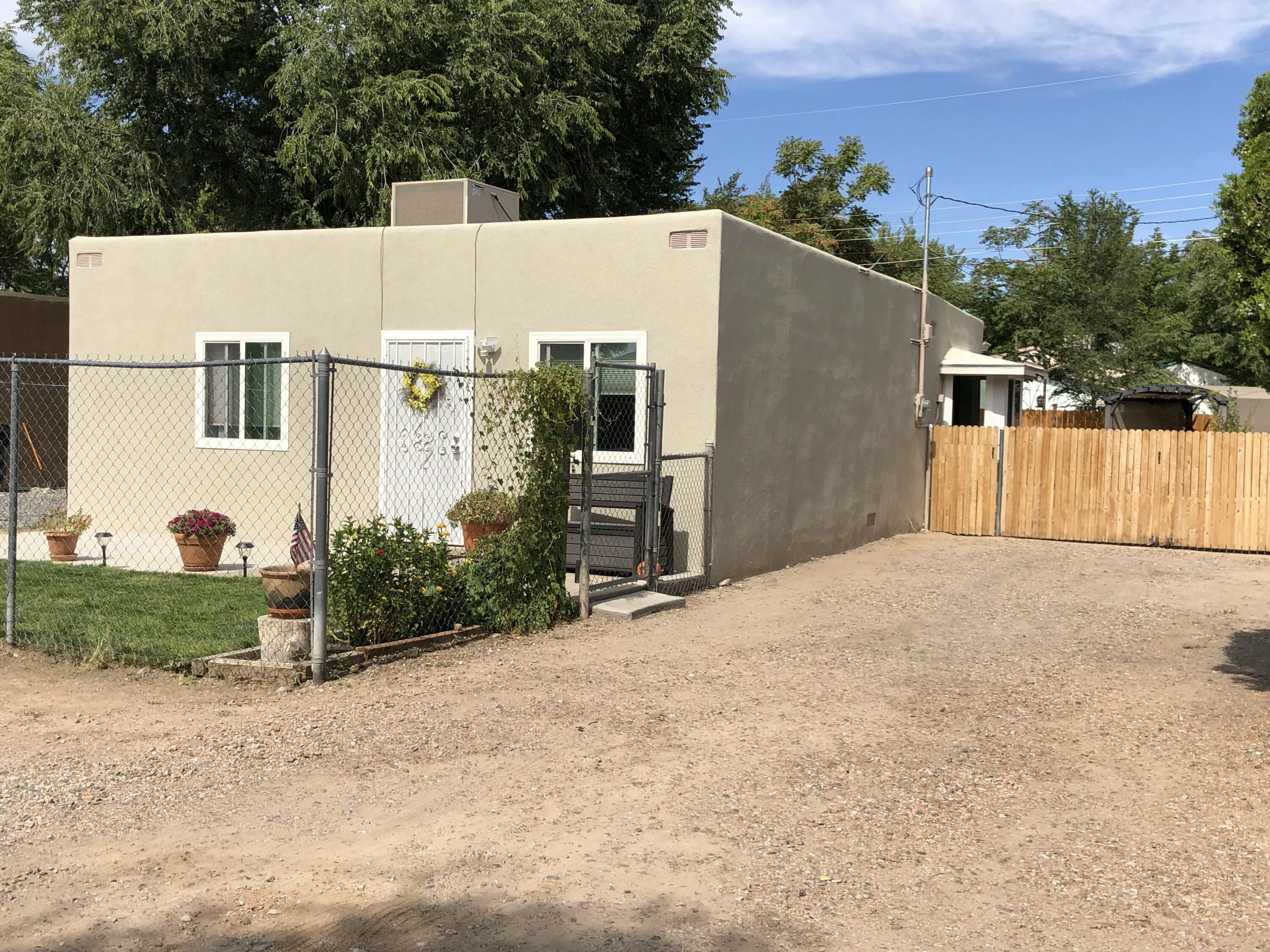 A must see south valley treasure. Lots of upgrades in this 3 Bedroom beauty. Roomy living area, great family kitchen and dining area. New 2021 bathroom. New 2021 synthetic stucco, 2021 Master cool unit.Double Pane Argon filled windows. Large backyard with cozy pergola sitting area for entertaining. Backyard access with fenced and gated front and backyard. 3 vary spacious  bedrooms. Fresh Home ready for it's new family.