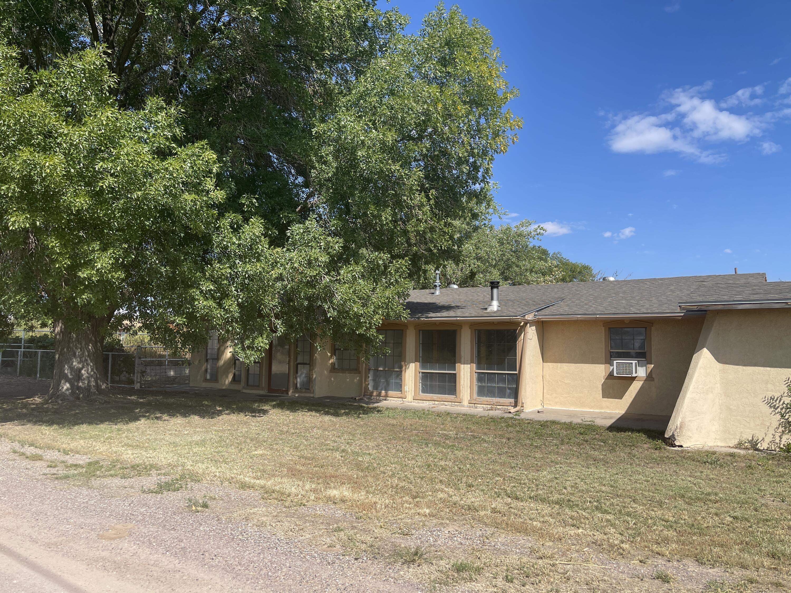 This property has it all, it sits on 3.2 acres of irrigated land.  Home is a three bedroom two bath with over 2100 sq. ft.  with a large master bedroom, open dining room and Livingroom area. The auxiliary building is 1500 sq. ft. with radiant floor heating, bathroom and reception area, and an oversized, attached garage.  The building is being used as a Kennel to board small animals.  This property has many opportunities and must-see.