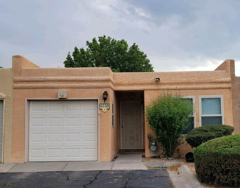Sweet 2 BR, 2 BA, 1 CG Townhome in  popular Chimney Ridge community. Easy access to I-25, restaurants, retail, services. Community is across the street from Arroyo Del Oso Golf Course, park areas, and walking/biking paths. Sliding doors, security doors, and some windows have been replaced. Front BR has engineered wood flooring. Small open-air Atrium with gorgeous wisteria off of Living and Dining rooms, and small Backyard with brick patio, established plantings, and small lawn area for your enjoyment out of the Back BR. Refrigerated air. Washer, dryer, refrigerator convey as-is. HOA covers community pool, tennis courts, common areas, clubhouse, streets, AS WELL AS roof, stucco, front landscaping, and water/sewer/trash services. Owner-occupied only, HOA does not allow rentals.