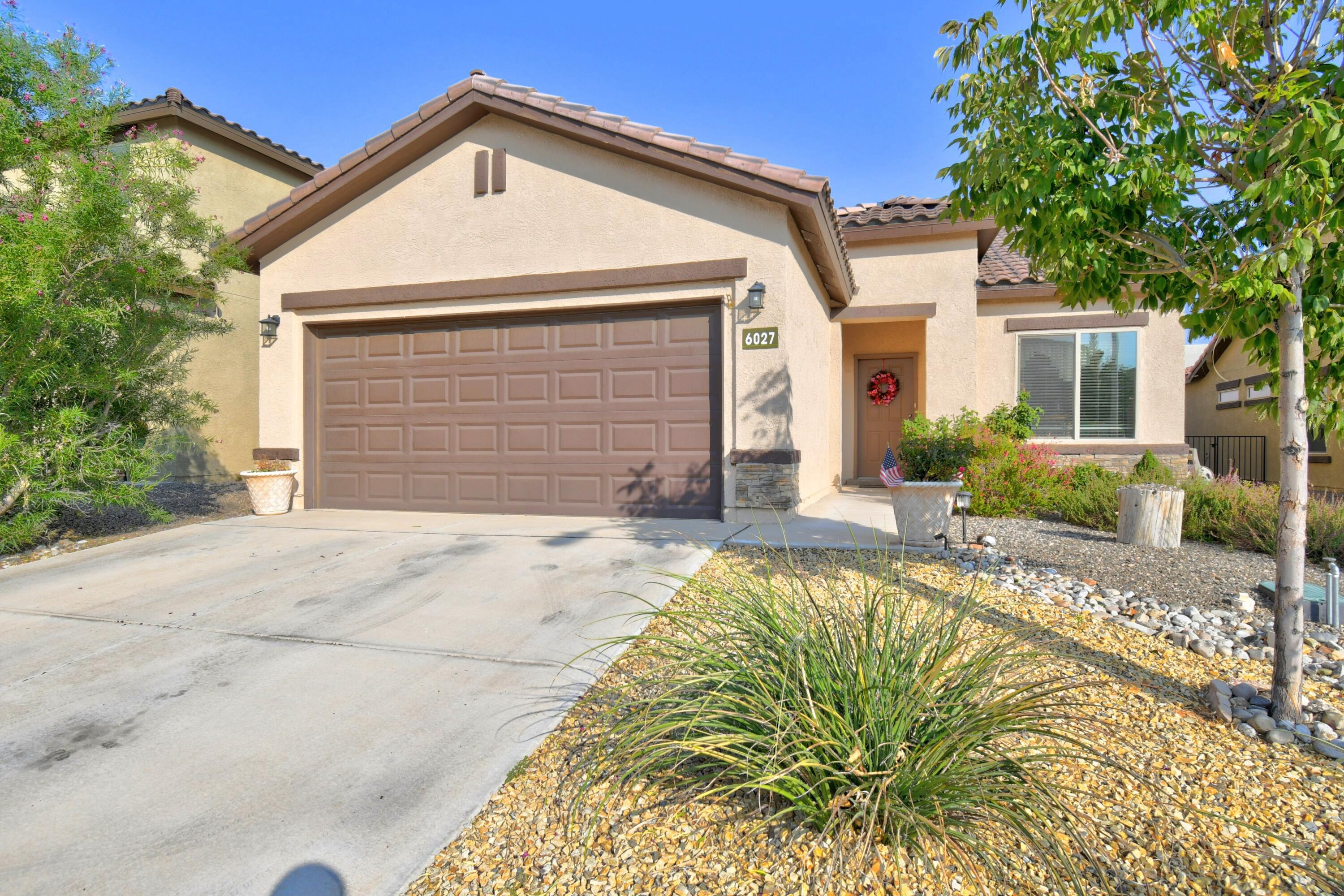 Pulte home in The Boulders subdivision features three bedrooms, two bathrooms, stainless steel appliances, granite countertops, bar in kitchen that overlooks the family room, covered patio in the backyard that has synthetic grass and is  xeriscaped , two car garage, and a tankless water heater.  Tile throughout the house except for the bedrooms.  Master bathroom has a shower and two sinks plus a large walk-in closet.   Main bathroom has two sinks and a tub. Near Paradise  Hills Community Center. Two nice parks in the subdivision and a large park across Paradise Road.  VA loan  is assumable if you qualify. Do not have to be a Veteran.If it sounds like something you would like, make an appointment to see it and make it your own.
