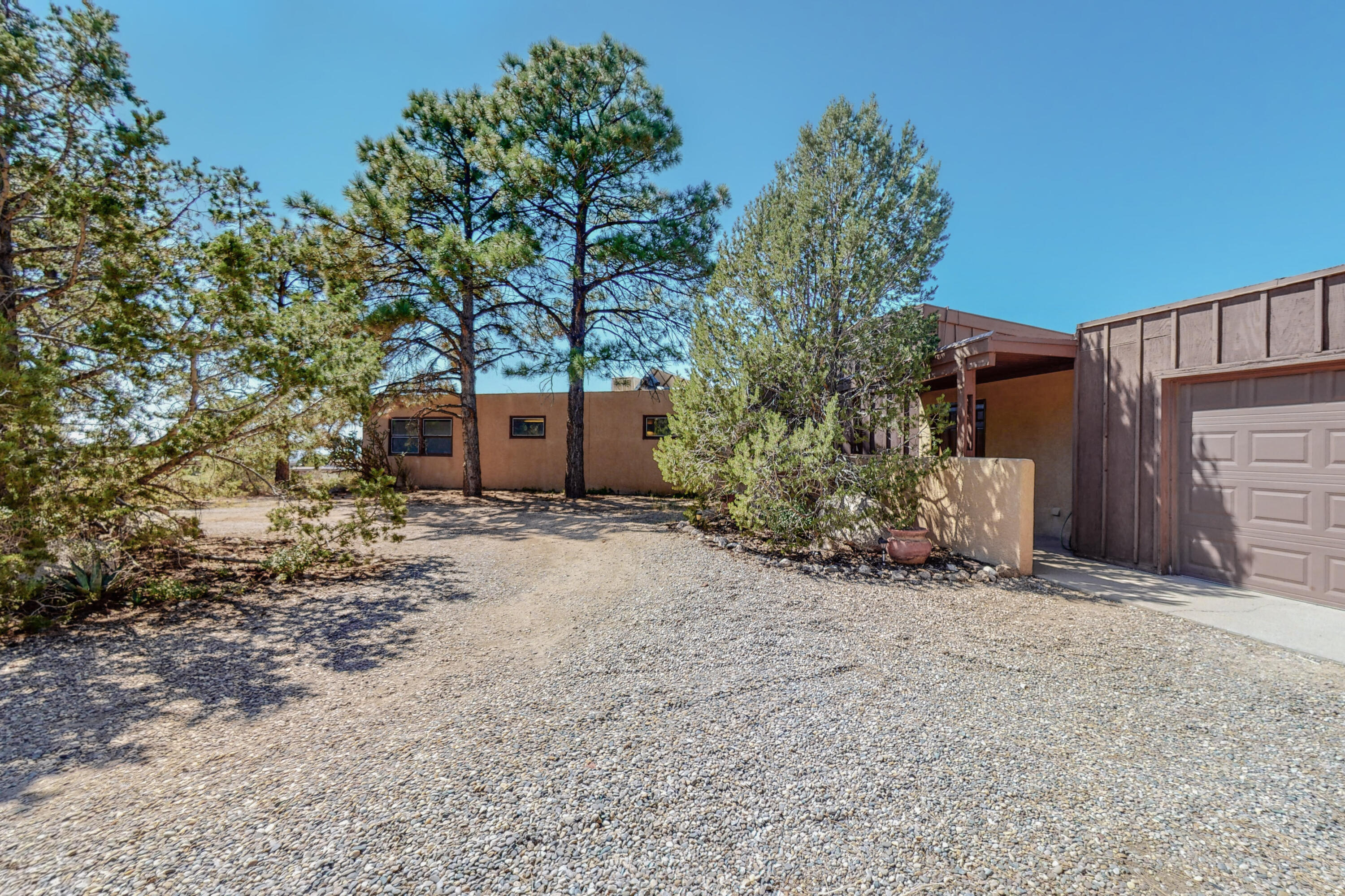 Welcome Home!  Views! 4 bedroom single story home now available in highly sought after Sandia Heights.  Home sits on nearly 3/4 of an acre.  Brand new carpet and fresh paint!  Large living room with open floor plan!  The best value in Sandia Heights!