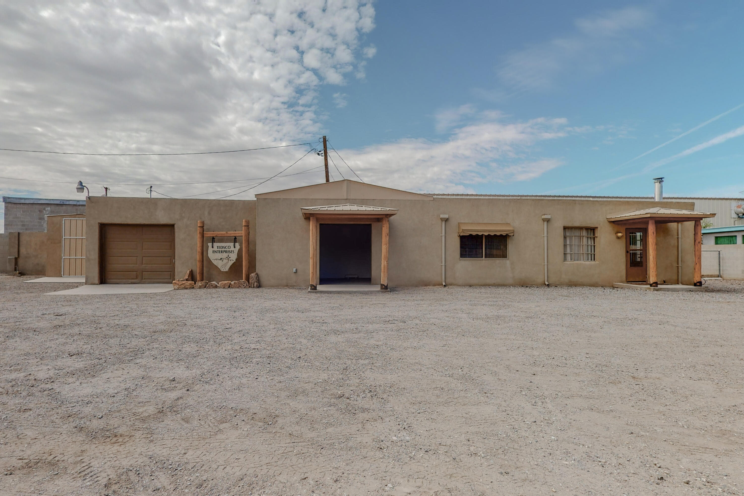 Incredible live/work space!  Great Value in the SW Heights with tremendous potential on a huge lot! Two contiguous parcels included in this sale! Parcel addresses are 3229 Tower and 3221 Tower.  3229 Tower has an oversized 1 car garage/workshop area, along with a kitchen, small office, 1 bedroom, and 1 living area.  200amp service, city water, private well.  Completely fenced with automatic gate.