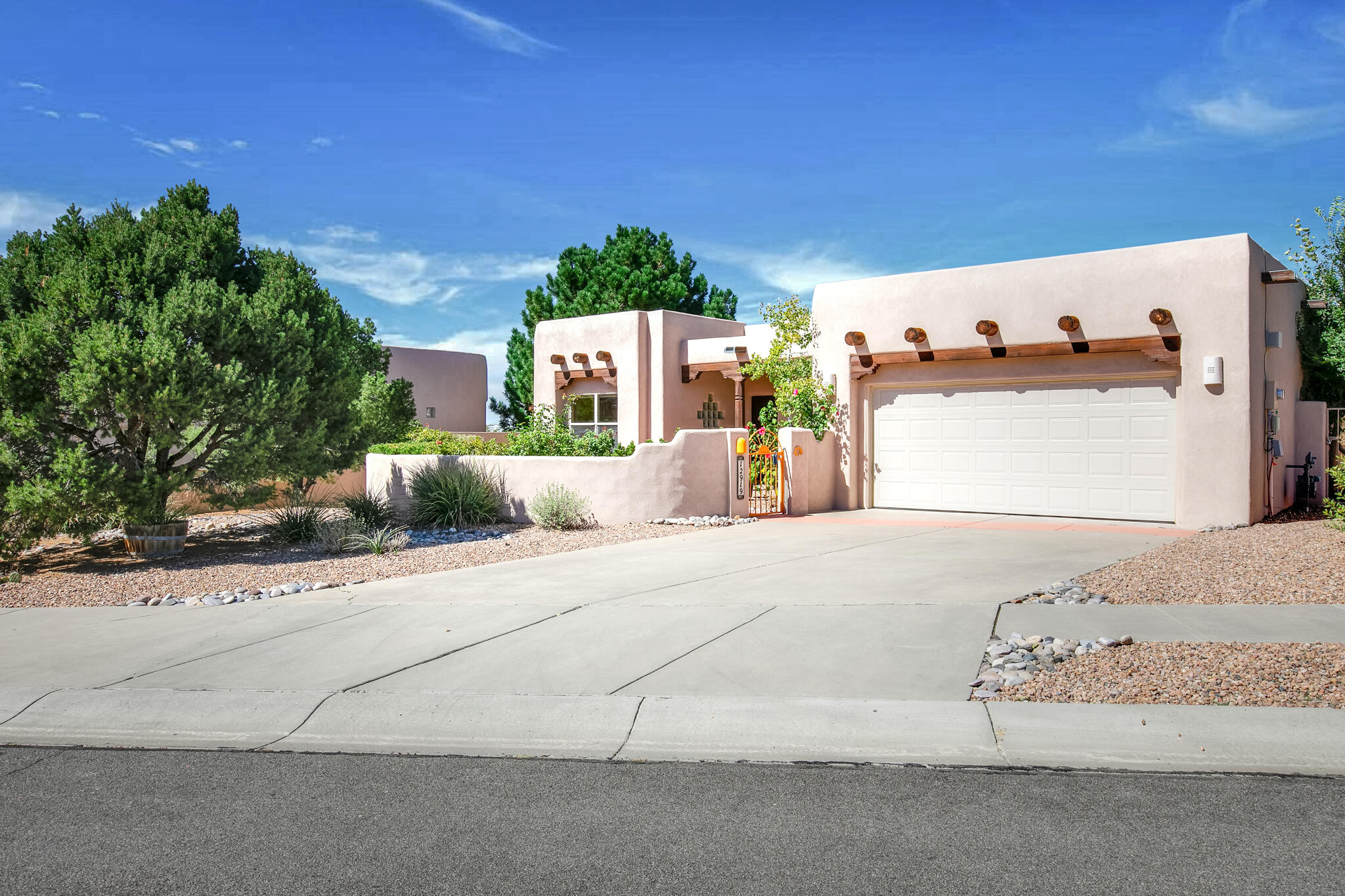 Single Level in High Desert w/ 180 degrees Unobstructed Mountain Views! A blend of southwestern & modern architecture styles, T&G ceilings, wood beams, kiva fireplace, curved walls, an abundance of windows & natural light flowing in from sunrise through sunsets! Open kitchen concept w/ island, breakfast bar, generous cabinet & countertop space + stainless appliances. The master suite has private access to the backyard, 8 ft. windows, 3-way fireplace, jacuzzi tub, walk-in shower w/ 2 shower heads & walk-in closet! The north-facing backyard has an expansive covered patio w/ plenty of space to enjoy the built-in natural gas BBQ & granite top. Spectacular views & no back neighbors for over half a mile! Convenient access to trails, grocery shopping & parks. Schedule your private showing today!