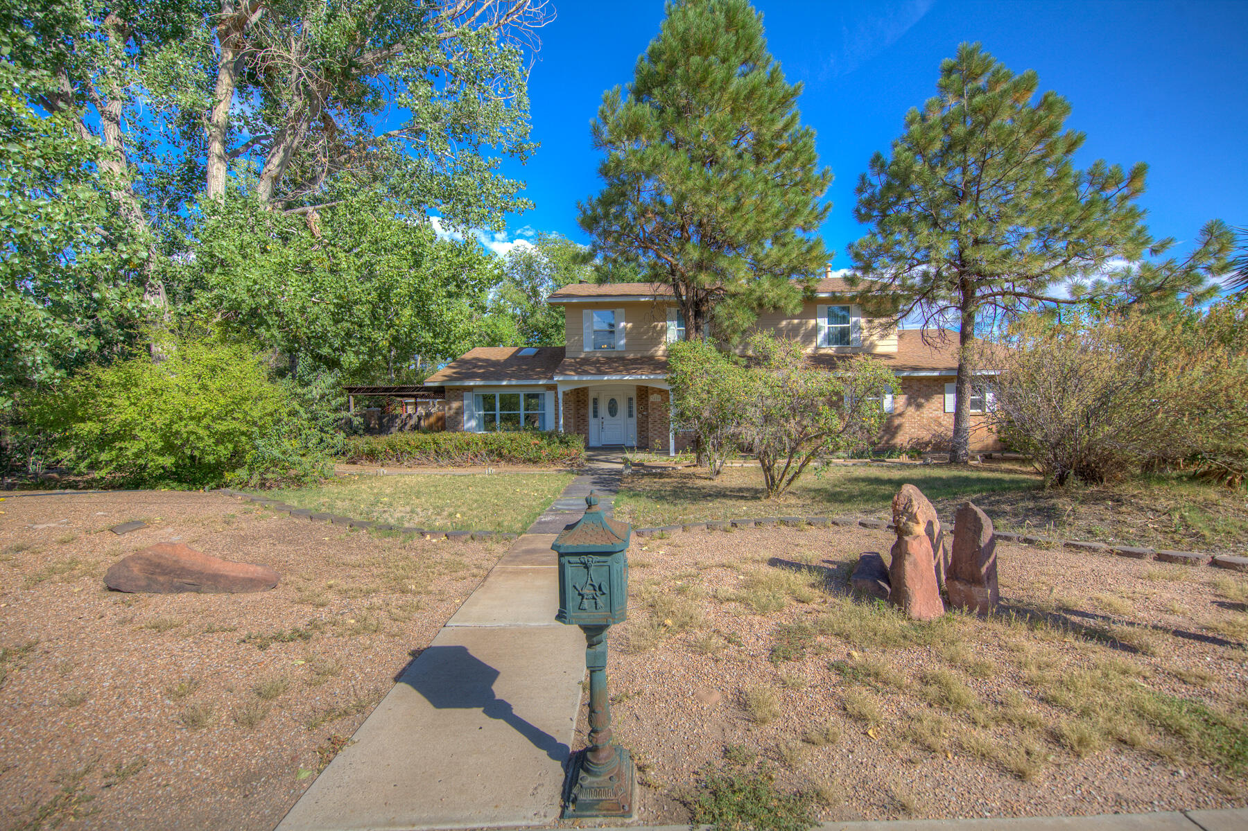 Great double lot .50 acre on corner. Large home 2700 sq ft 3 bedroom 2.5 bath. Master is up-stairs with views. Make offer today. New roof.