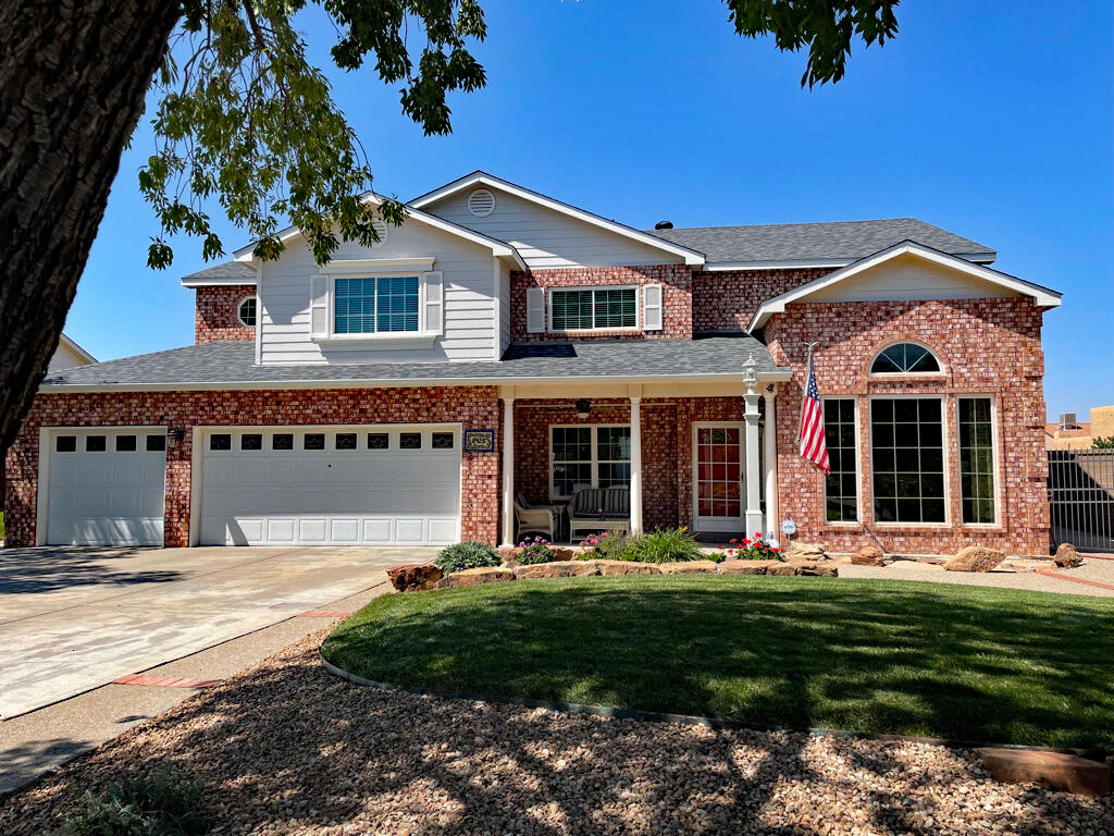 Beautiful colonial brick 5-6 Bed, 3-car home, 2991 SF, on an elevated premium view 11,282 SF corner lot on a cul-de-sac!  Remodeled and upgraded inside and out, includes:  Refrigerator, Freezer, Hot Tub, Billiards Table, Gazebo, 6 Samsung smart hdtv's.  Awesome mountain and valley views!  New kitchen with granite, upgraded cabinets to ceilings, porcelain floors, picture windows, stainless steel appliances, canned LED lighting.  New Master Bath with soaking tub, floor faucet, frameless shower, cabinets & shutters.  New surround sound home theater with built in cabinets.  All new interior and exterior doors, windows and trim.  2 second floor decks with French doors and blinds in glass.  Curbside appeal, location, La Cueva school district, parks, multigenerational  community center.