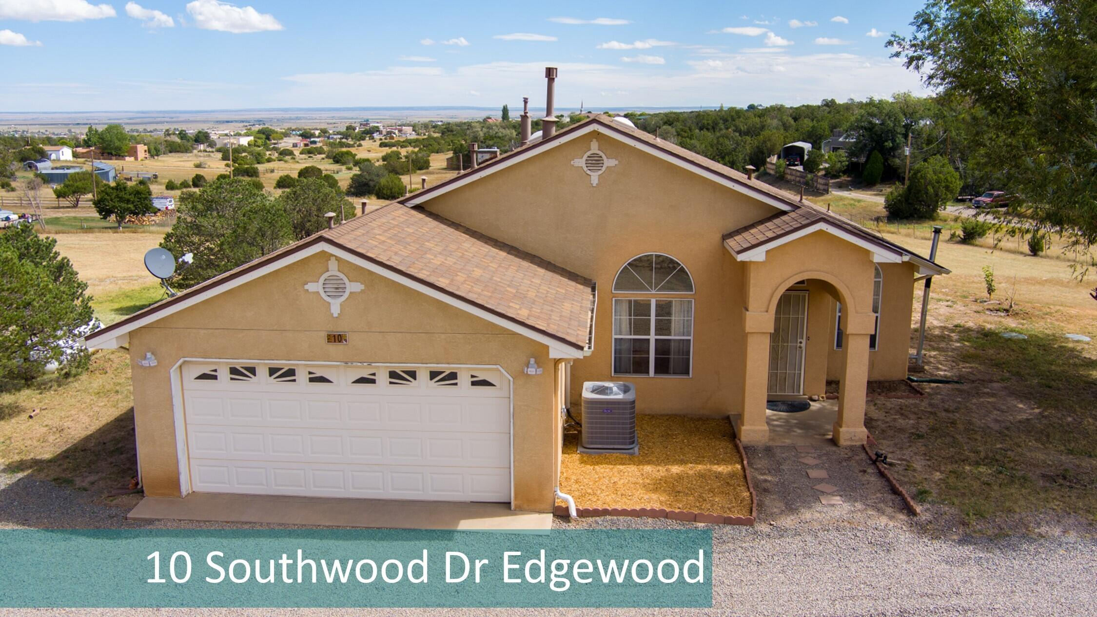Ready for the peace and quiet of the country with convenient city amenities?  Then you'll love coming home to this single-story on 2 acres just minutes from I-40 and shopping/eateries.  The property is totally fenced with an additional/smaller fenced area from the back patio AND a dog run.  Updates in 2021 include water heater, refrigerated air/furnace combo unit, Samsung side-by-side refrigerator, Puronic reverse osmosis, and grading/gravel for improved drainage.  And roof and water softener less than 2 years old!  Appealing floor plan with master bedroom separate from the other 2 bedrooms.  Luxuriate in your soaking tub and separate shower!  Open kitchen to family room and views to the backyard. Plus a 2nd living area and formal dining room! And 2 storage sheds and pole barn/RV parking!