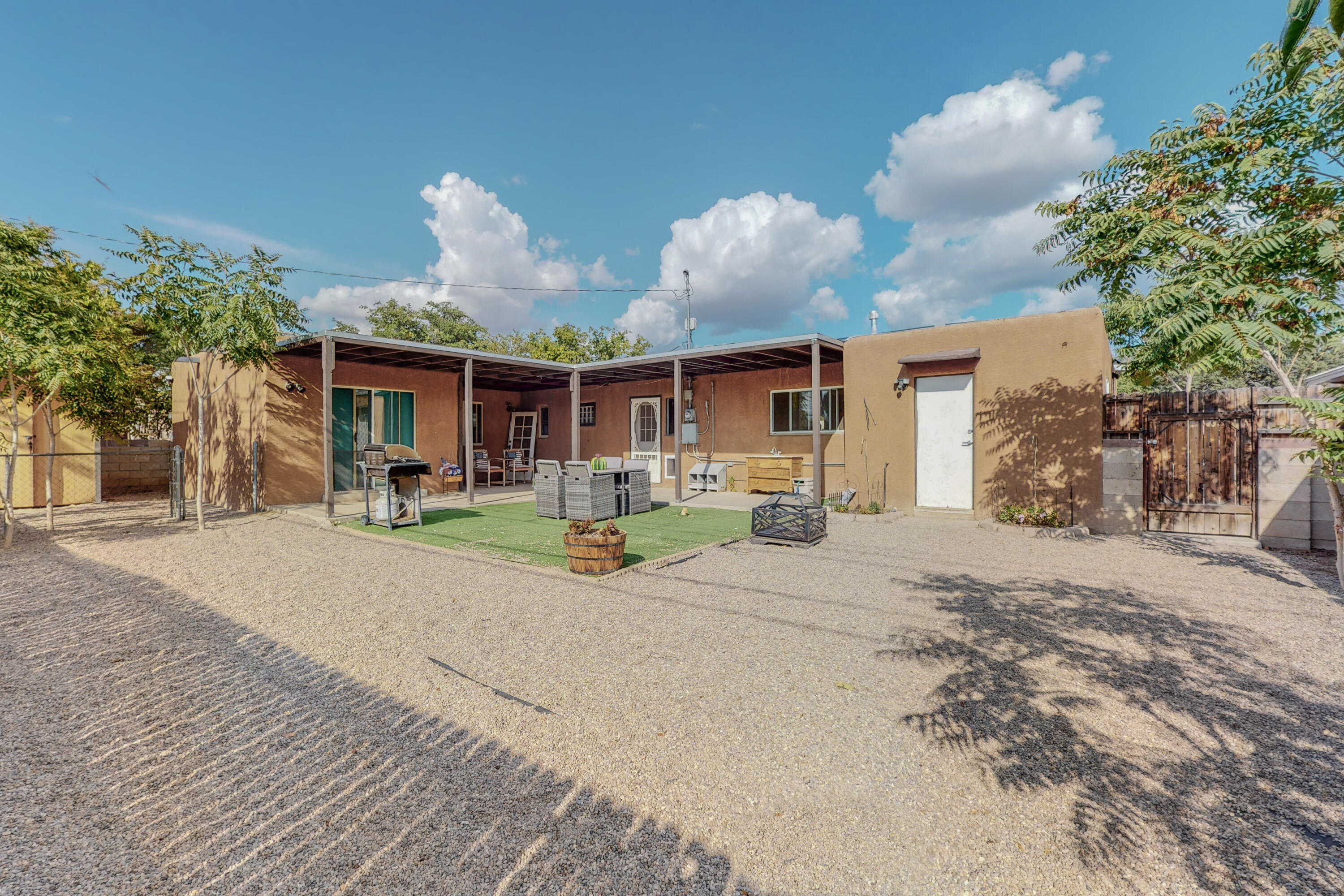 Come see this one before it's gone! Walking distance to park, school, ABQ Uptown, Trader Joe's. Easy freeway access. New Refrigerated Air/Heat unit, see invoice in documents. Added 220 volt circuit to service panel. Vent added to heat/cool laundry room. New Roof 3/2019.  Landscaped backyard with gravel and turf. Huge Sturdy Shed in backyard. Ever dreamt of having a dressing room? Well now is your chance. Owner's Suite has 3 rooms. Make one your gym or studio and one your dressing room. Adorable French doors separate the living room from either another bedroom, or an office with extra large walk in closet. Don't forget to check out the secret passageway from the coat closet into the first bedroom! And did I mention the oversized Laundry Room?