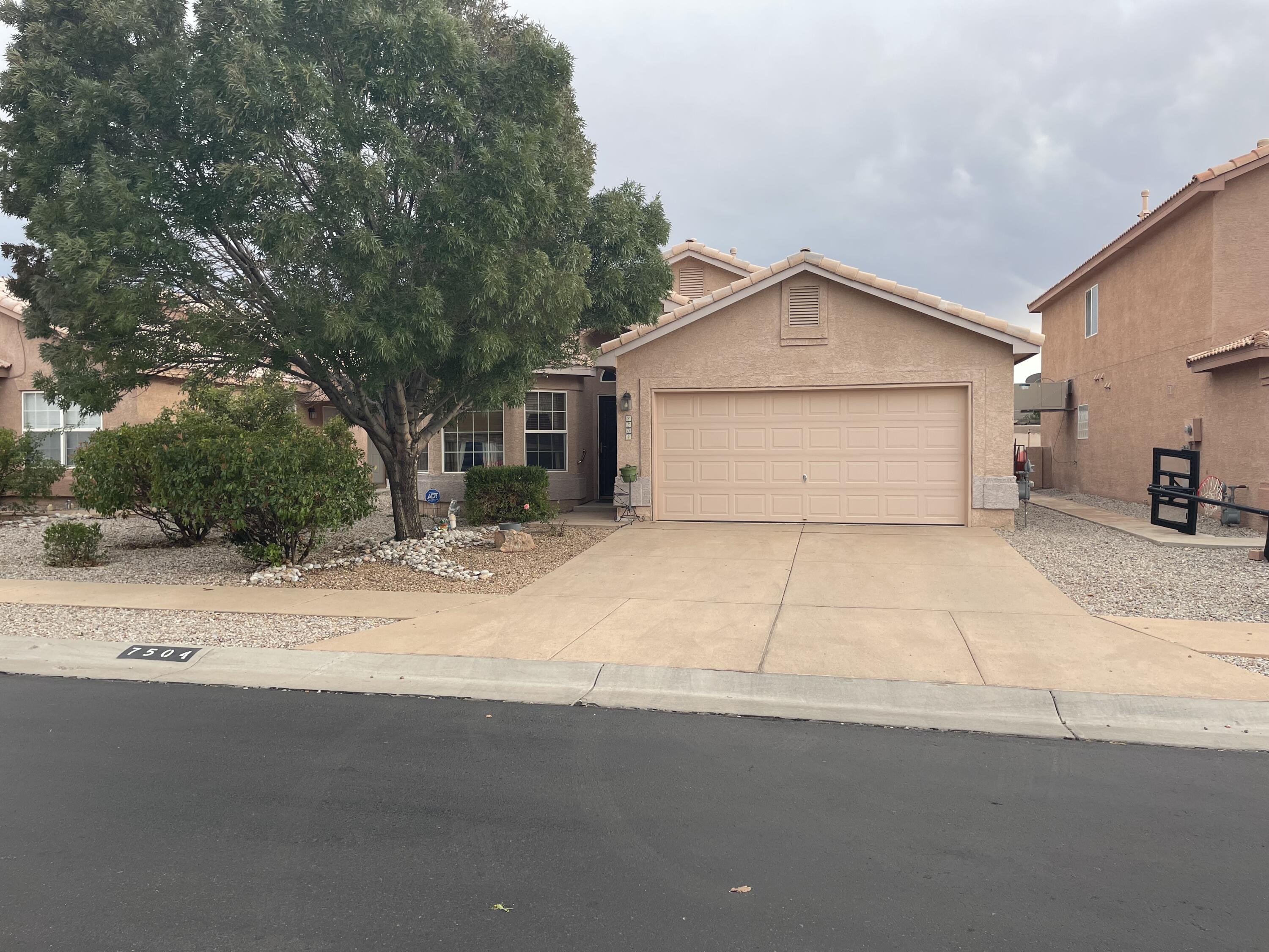 Encanto Village gated community is an oasis in SW Albuquerque. This single story home features two large living areas with an open floor design. The primary suite is expansive with a large tub and a huge closet. Long lasting tile roof, refrigerated a/c. A healthy peach tree in the backyard will provide for all your baking needs.