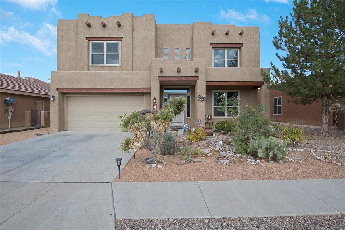 Don't miss your opportunity to own this incredible Vista Del Norte beauty tucked away in a quiet cul-de-sac. Gorgeous porcelain tile throughout the main level which includes formal living and dining plus large great room with kiva style gas fireplace. Chef's kitchen with recent stainless steel appliances including refrigerator, tons of cabinet space and stunning granite topped island. Upstairs find 4 generous sized bedrooms including the enormous master suite with sitting area/den, the master bath boasts a jetted tub and separate shower plus a huge walk-in closet. There is trex deck balcony off the master suite with sweeping views of the Sangre de Cristo mountains all the way to the Manzano's. Fully landscaped front and back with an east facing backyard providing lots of shade on those hot