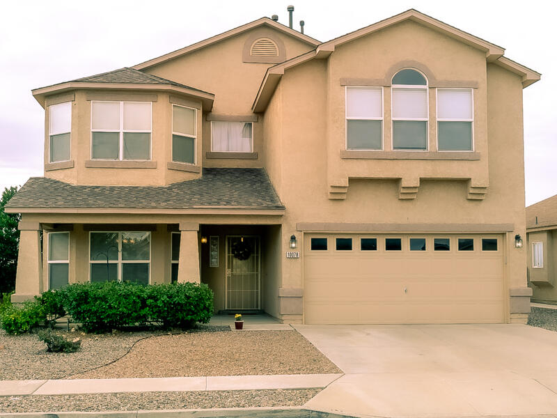VIEWS AND MORE VIEWS of green grass and SANDIA MOUNTAINS. Enjoy Beautiful evenings from either your downstairs covered patio or upstairs balcony while enjoying beautiful views and even balloons landing out your back door. Home has 4bedrooms one large that can be exercise room or large office big enough for two. Upgrades include appliances, granite counters, backsplash, garbage disposal new bottom up top down blinds, new carpet, water heater and more. Backyard is low maintenance with new Syn Lawn,  leaving time to enjoy those views.  Master has ample room for sitting area and opens to your own balcony to enjoy your morning coffee. This one is move in ready .