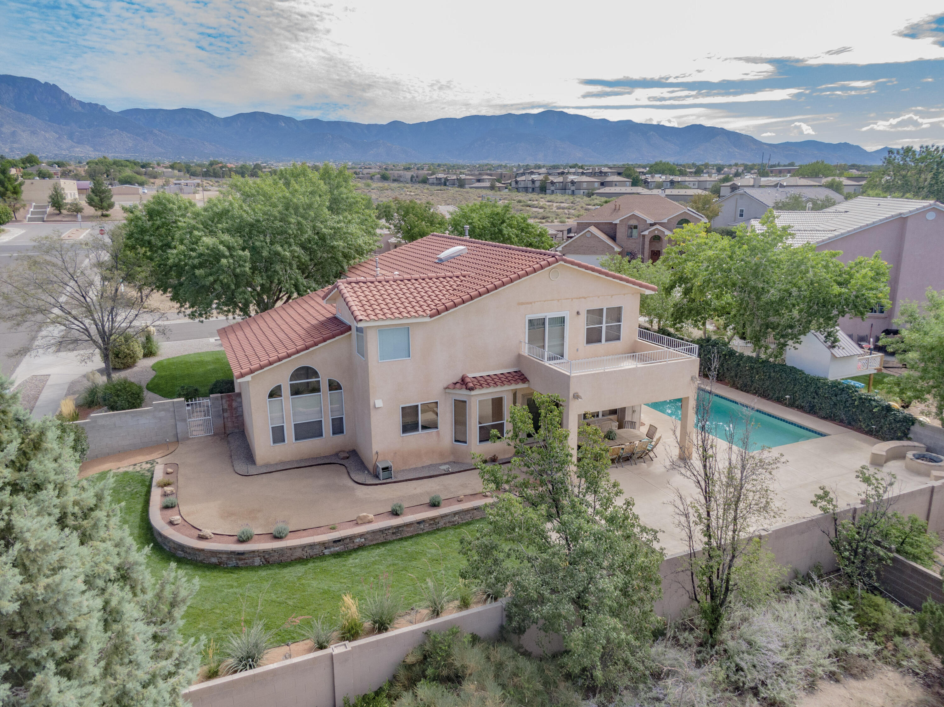 Spacious home located in the sought after La Cueva school district on a quiet cul de sac. Bedroom 1 is located downstairs w/ a 3/4 bathroom around the corner making for a great guest suite or in-law quarters.  No stairs for mom & pops!  Master bedroom is large and features 2 very expansive closets!  Balcony off the rear of the master with a new membrane cover.  Downstairs you'll find a living room & family room, plus a dining space AND eat-in kitchen.  But the prize of this home is the wonderful outdoor space!  Lush & beautifully maintained lawn in the front and back w/ 4 zone sprinkler system.  Plus a great corner lot which is just over a quarter acre!  Covered patio, firepit w/ built-in banco, In-ground Saltwater pool features an automatic lockable cover, plus a solar heater.