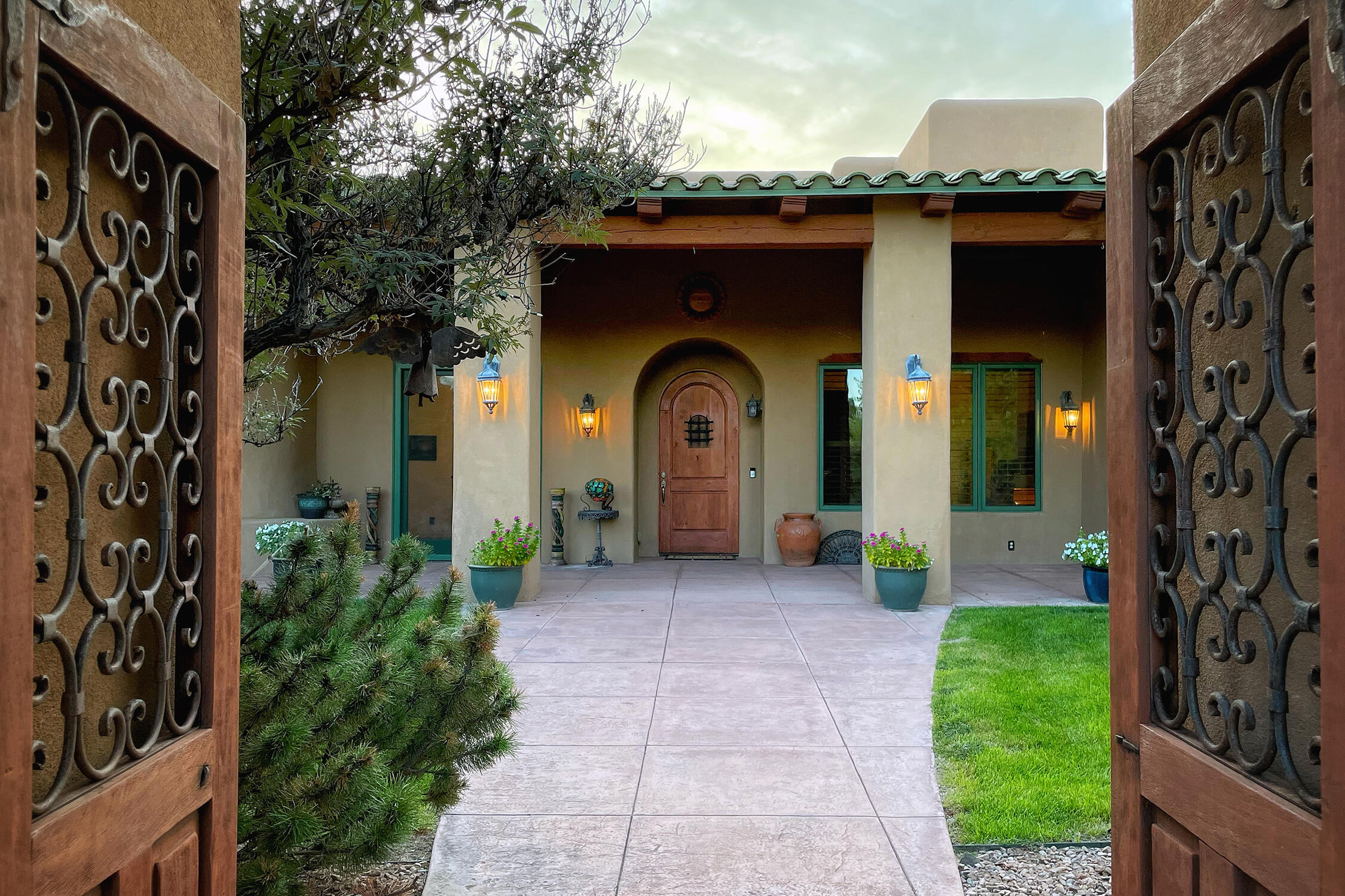 Located in the pristine Los Poblanos Orchards gated community this 5100 sq. ft. home, with additional 1090 sq. ft. 4 car garage, 1308 sq. ft. pool house, and so much more, offers ample space to accommodate all lifestyles. Custom finishes throughout the home, including Venetian plastered walls, newer roof, granite countertops, Wolf kitchen appliances, custom cabinetry, and custom solid surface flooring. Grand entry and sensible floor plan with tall ceilings throughout.  Spacious 1.2 ac lot with plenty of parking and space. Entertain year-round with the outdoor grill, heated pool, hot tub and a custom pool house with panoramic sliding glass doors, outdoor fireplace features, portals, and an outdoor kitchen/bar. An added perk is the separate irrigation well to maintain the lush landscape.