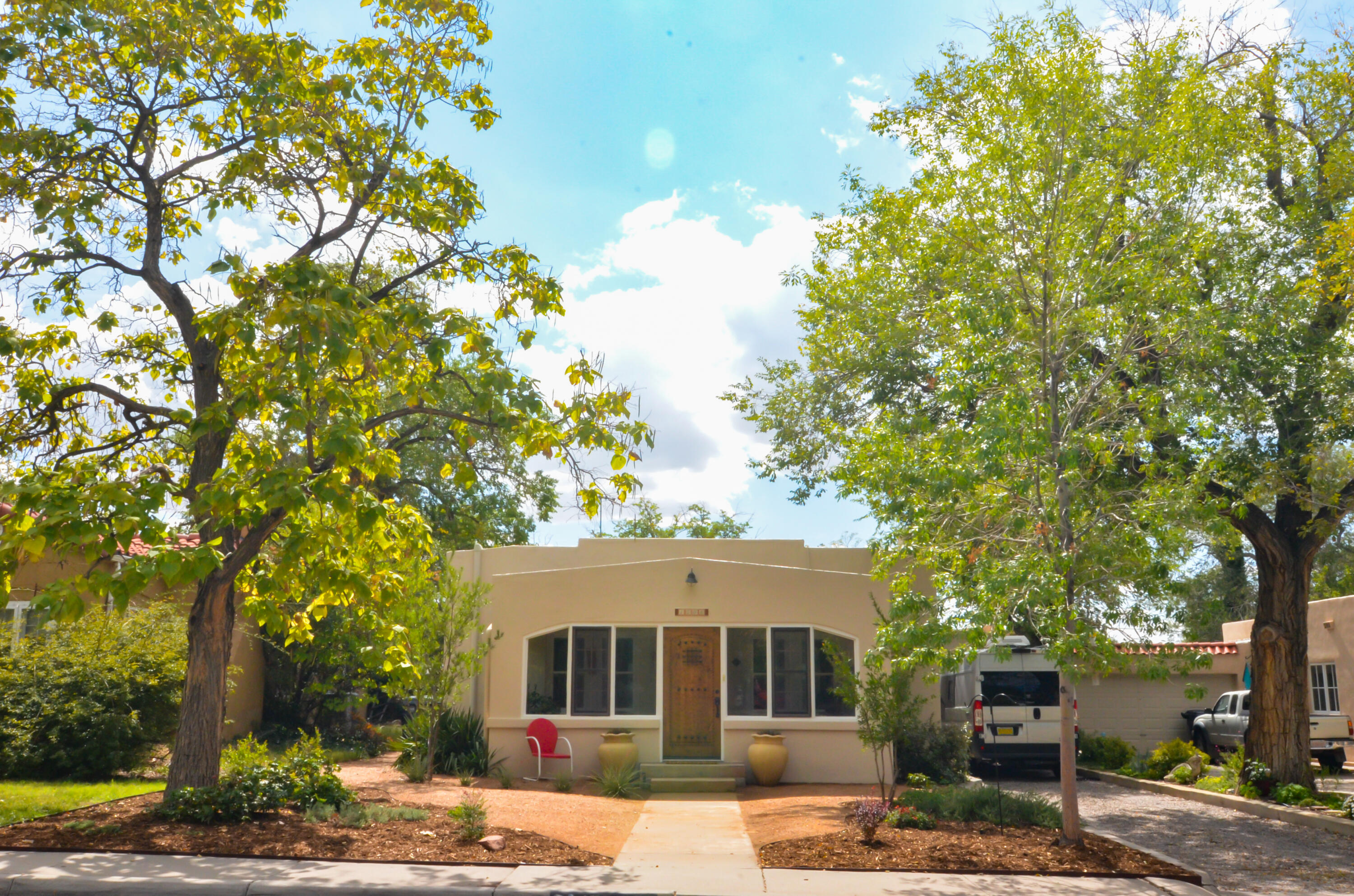 Spruce Park Charmer with Immaculate Appeal. A wonderful blend of vintage features + modern day conveniences.  For the pool enthusiast a rare find - Indoor Salt Water Pool with automatic cover.  Enjoy the front porch and wave to friendly neighbors all year long. Open floor plan is entertaining friendly with polished hardwood floors, fireplace (wood insert for chilly evening)s & original built in book cases. Opening off  living room is a study or 3rd bedroom . Spacious master retreat offers a sitting room, ample closet space & direct access to the pool. Murphy bed in bedroom 2. Mini splits in addition to CFA  for great heat control and refrigerated cooling in the summer.  A short block to the park, a longer block to UNM. Downtown, hospitals, Nob Hill all close by - best location!