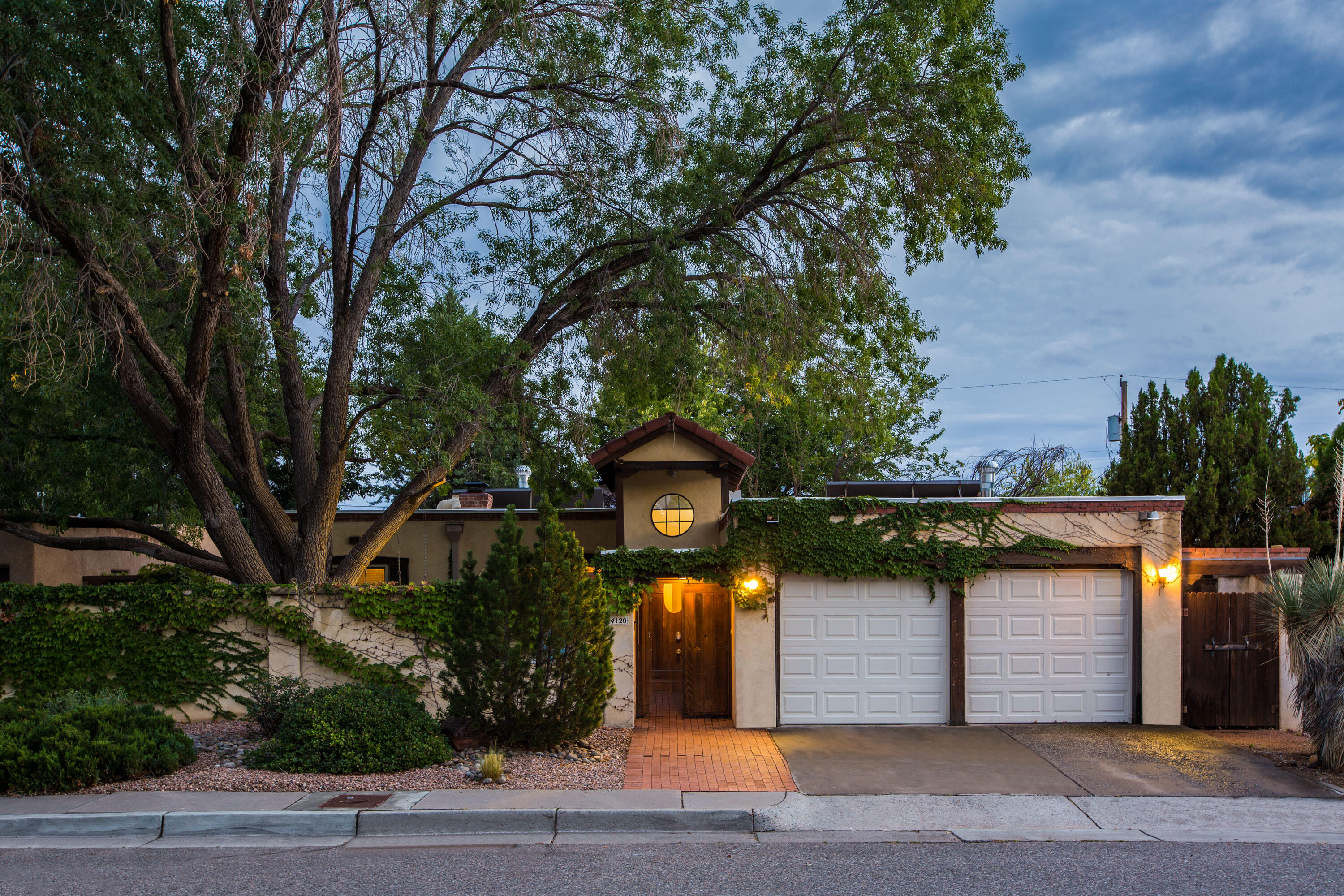 This quaint mission-style home is located in a quiet neighborhood with mature trees and walkable/bikeable streets near schools, parks, entertainment, dining, and shopping. The property is only minutes away from the experience of Nob Hill, the university, hospitals, transit, and freeway access. The split bedroom floorplan has the primary bedroom suite separated from the other rooms. The spacious family room has an abundance of natural light, and is cozy enough for small gatherings yet big enough for larger receptions. There is plenty of privacy with a large front courtyard and walled backyard, and the lush verdant landscape provides the perfect setting for your oasis. With everything this home has to offer in charm and amenities life will undoubtedly be a sweeter here.