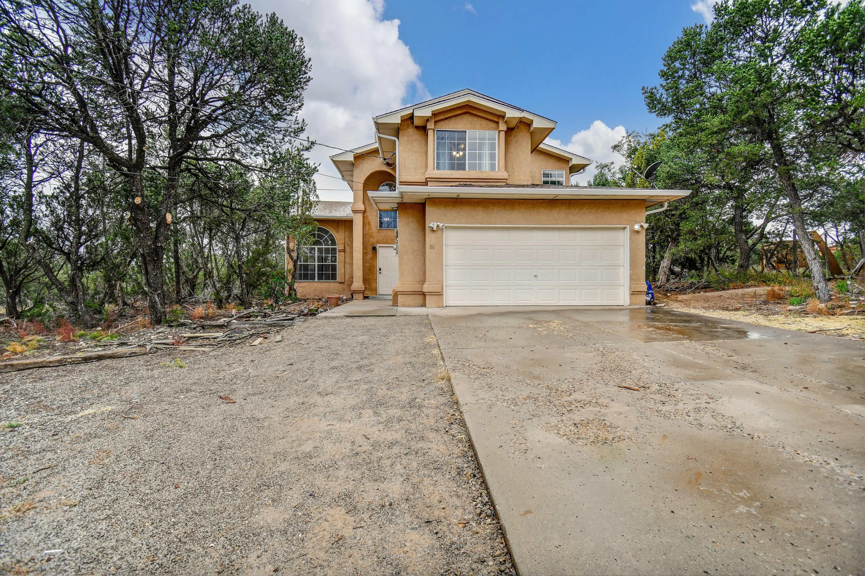 Welcome Home! This amazing home features four bedrooms and an open floor plan with soaring ceilings. The large master retreat includes separate shower/tub, walk in closet, and a private balcony where you can enjoy watching nature from afar. The second living room has a wood burning fireplace. Outside you will find a covered patio where you can relax and enjoy the views.