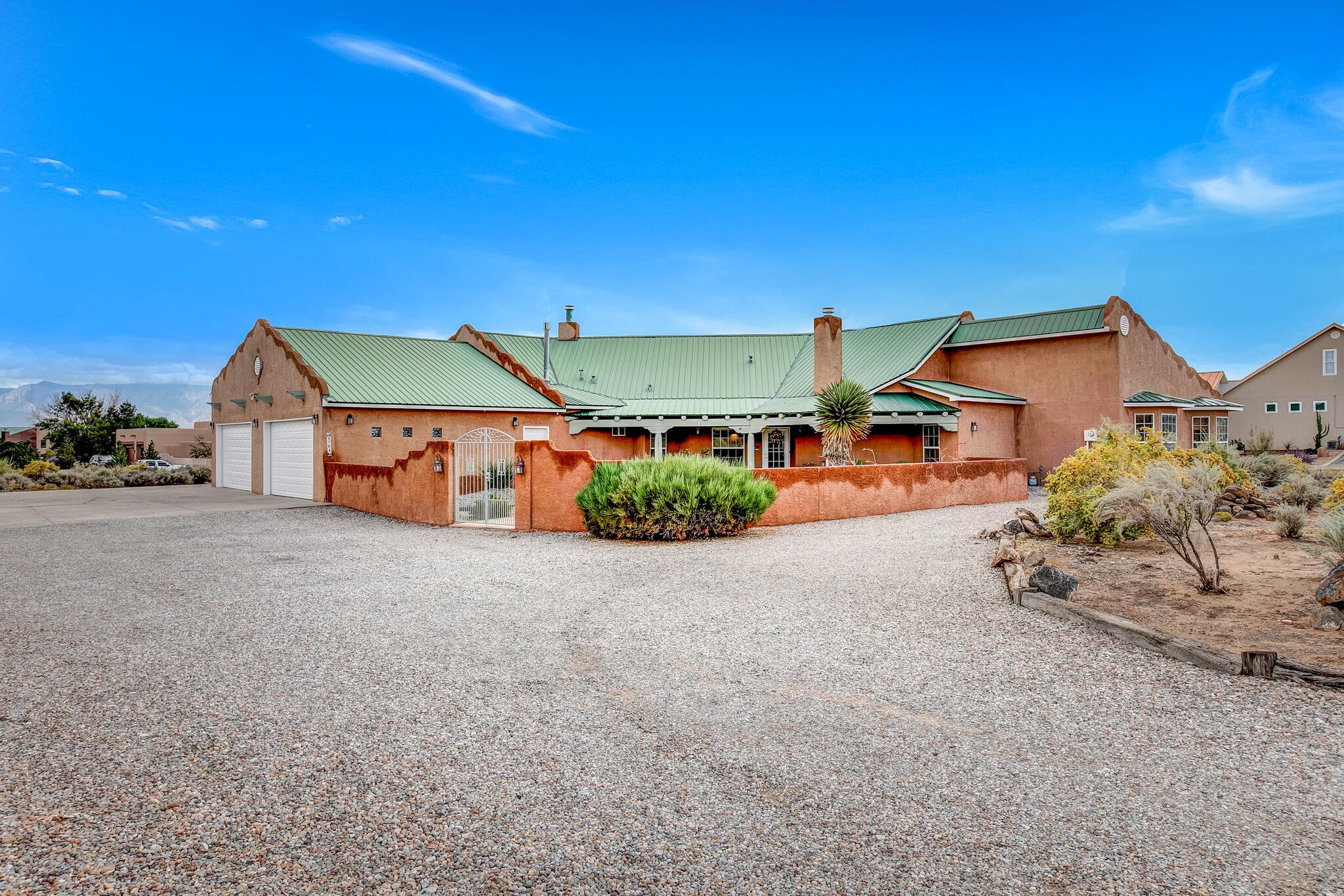 Welcome home to this magnificent Southwest custom filled with charm!  The open floorplan is perfect for entertaining or family gatherings.  Large kitchen offers updated appliances, wrap around breakfast bar with plenty of seating, and cabinets/counters GALORE!!!  Romantic primary suite includes sitting area, fireplace, 5 piece bath, huge walk in closet, and access to the patio where the hot tub is just a few steps away.  Ample sized additional bedrooms are separate from primary.  Oversized 4 CAR garage includes an extra storage room too!  One acre lot is natural landscape and inside the private courtyard and backyard are southwest native plantings.  On occasion, there's even the opportunity to see a few  hot air balloons floating overhead!!