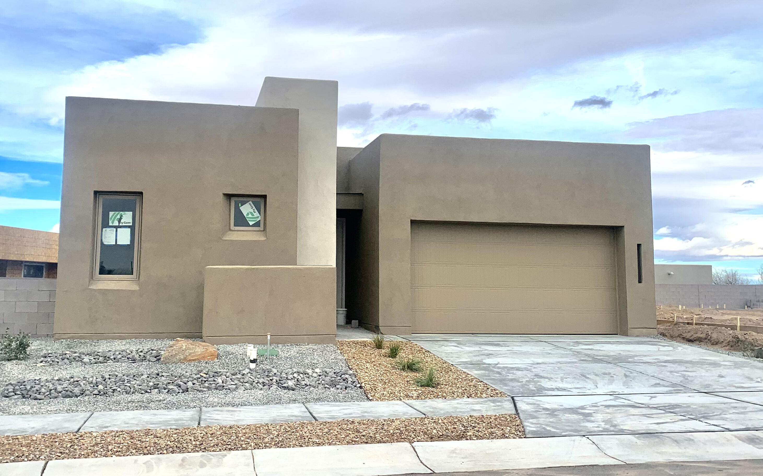 Another Gorgeous Abrazo Home.  The Eileen located in Ascension at Balloon Fiesta Park, a gated community.   The Eileen includes 2037 sf with 12 ft ceiling in great room an clearstory windows for plenty of light. Cabinetry, tile and countertop upgrades throughout along with 8ft sliding patio door and deck option.