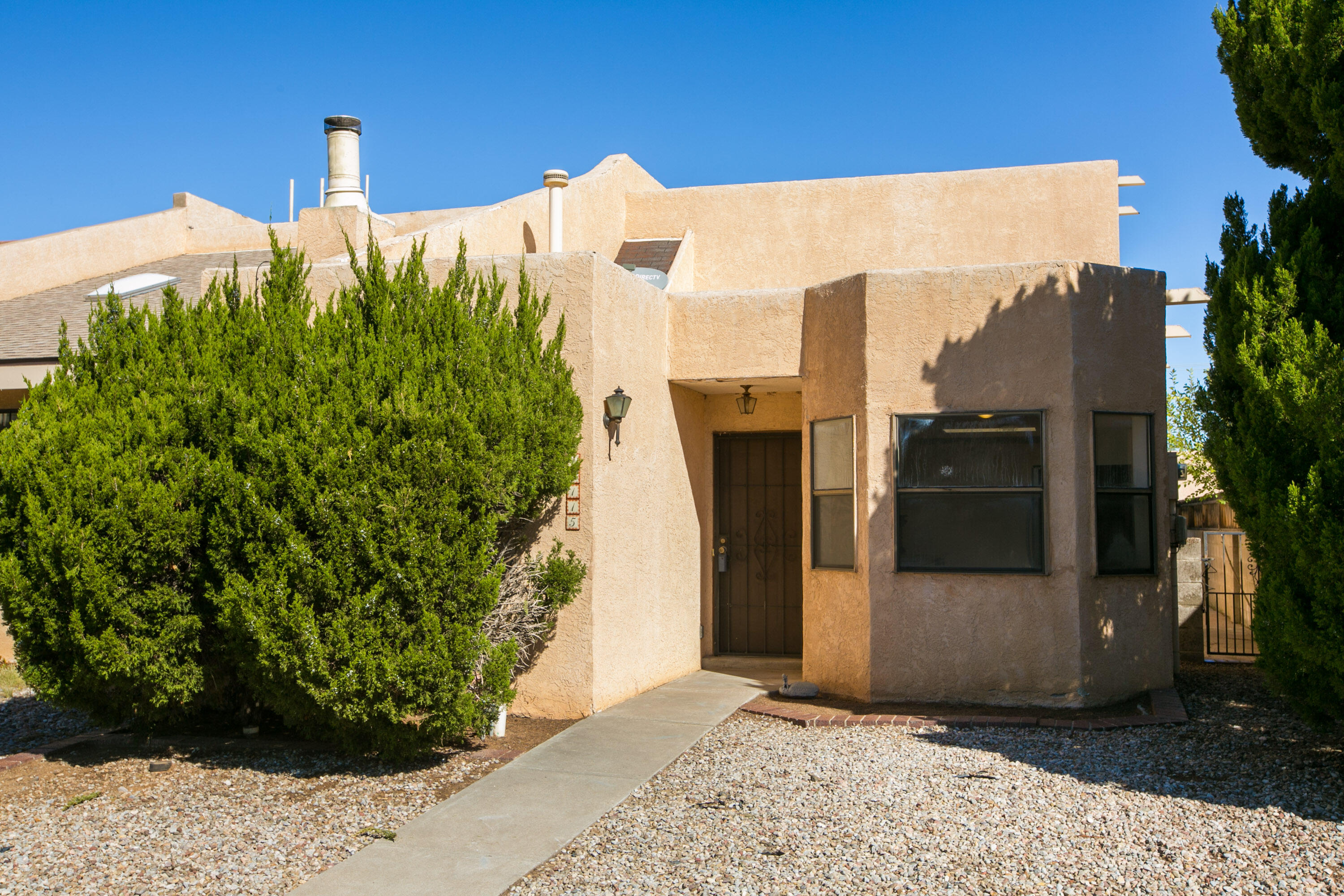Charming Two bedroom, Two Bath Townhome located in the NE Heights with new Flooring, Freshly painted, New light fixtures. Front windows being replaced. Views from the upstairs balcony of the Sandia's.  Backyard access. Possible to build a detached garage.Take a Look Today!