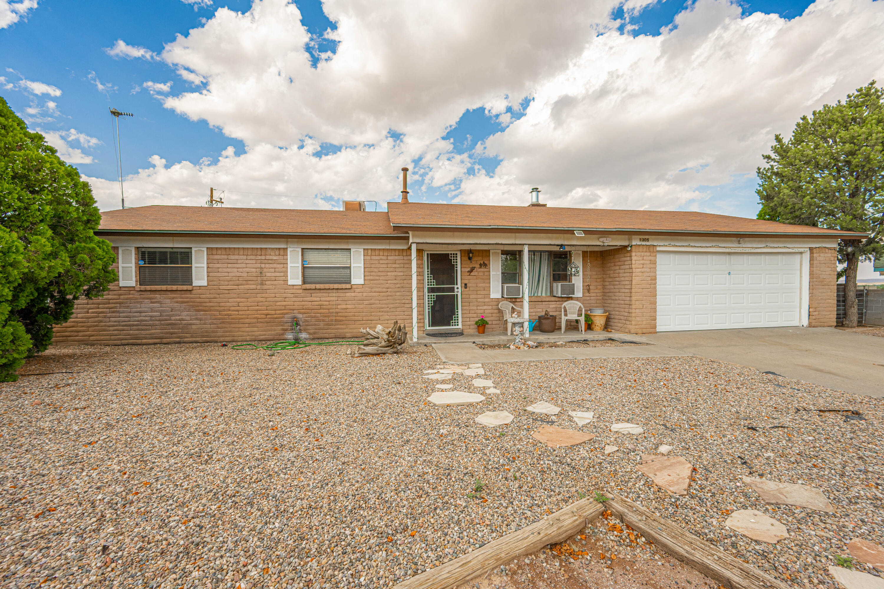 Beautiful brick home in Hilton Hills Subdivision on an established cul-de-sac blocks from NMT, the golf course and NRAO.  Open floor plan with sunsets out the back w/unobstructed views of the mountains!  If you gaze up at night, you'll never stop being amazed to see the Milky Way just overhead. This home features a wood burning fireplace w/cooktop, formal DR, 4 bedrooms w/2 amazing master suites w/updated bathrooms, updated kitchen comes w/stainless-steel appliances, double sink and breakfast bar w/extra lighting.  Laminate wood floors in common areas of the home and carpet in the bedrooms. The backyard is spacious w/covered back patio, extra concrete slabs, mature fruit trees, several storage options and backyard access.  Plenty of room for your toys! This beautiful home is ready for you!