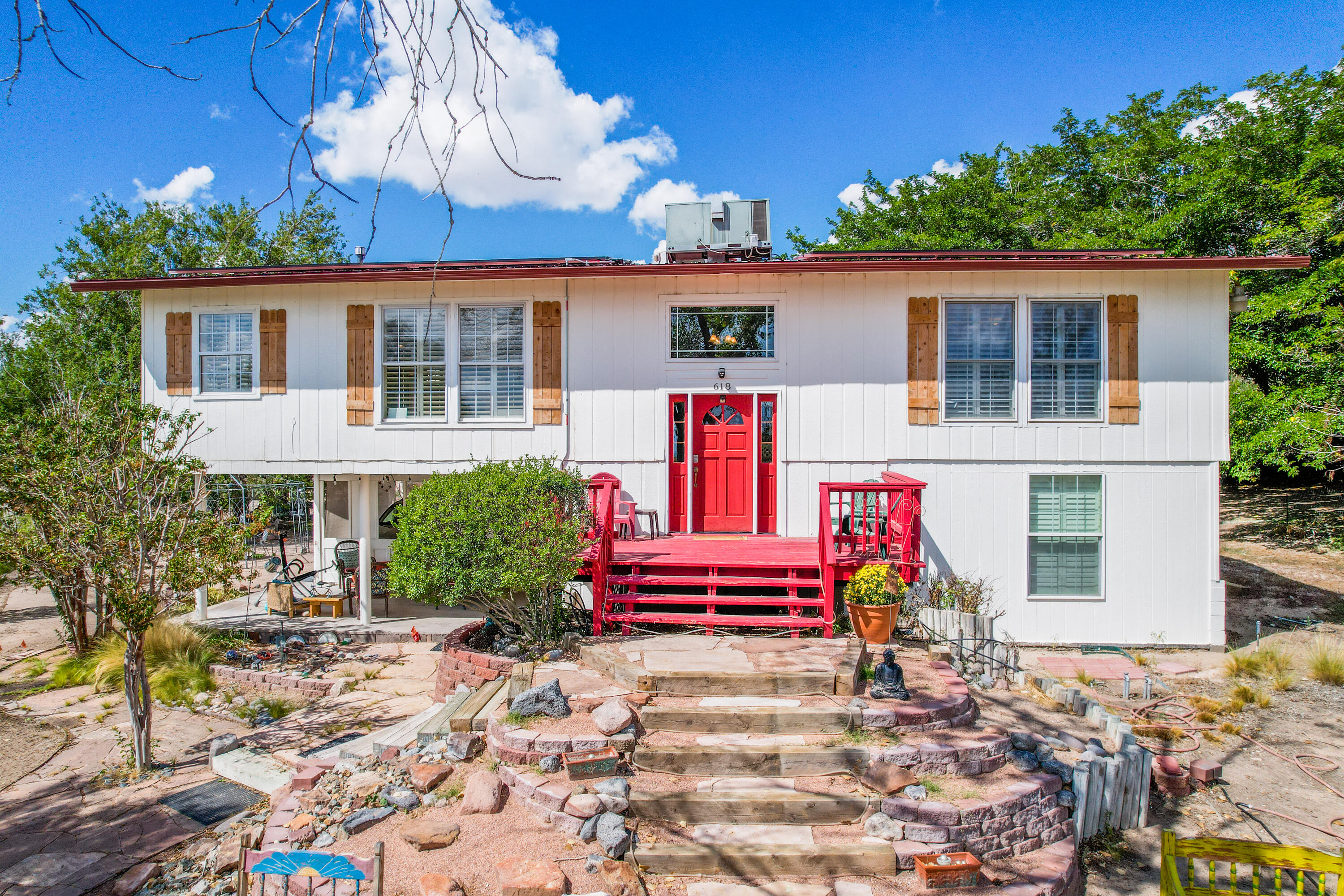 This unique Property in the Village of Corrales carries with it a variety of opportunities!  Presently operated as a permitted  Air B&B. The downstairs of this home is set up as a Casita with long term tenants renting month to month at $900.00.  The upstairs has 2 Large bedrooms, a Large Kitchen open to the living /Dining rooms. Add to that an Incredible view.  The Detached Studio/Workshop/multi purpose building has Lots of potential uses.If a new owner wanted to just keep everything as-is, with the rental income counted it's like owning a home valued at $565,000.00, But paying for a home that costs $365,000.00.Take a look at this opportunity today!