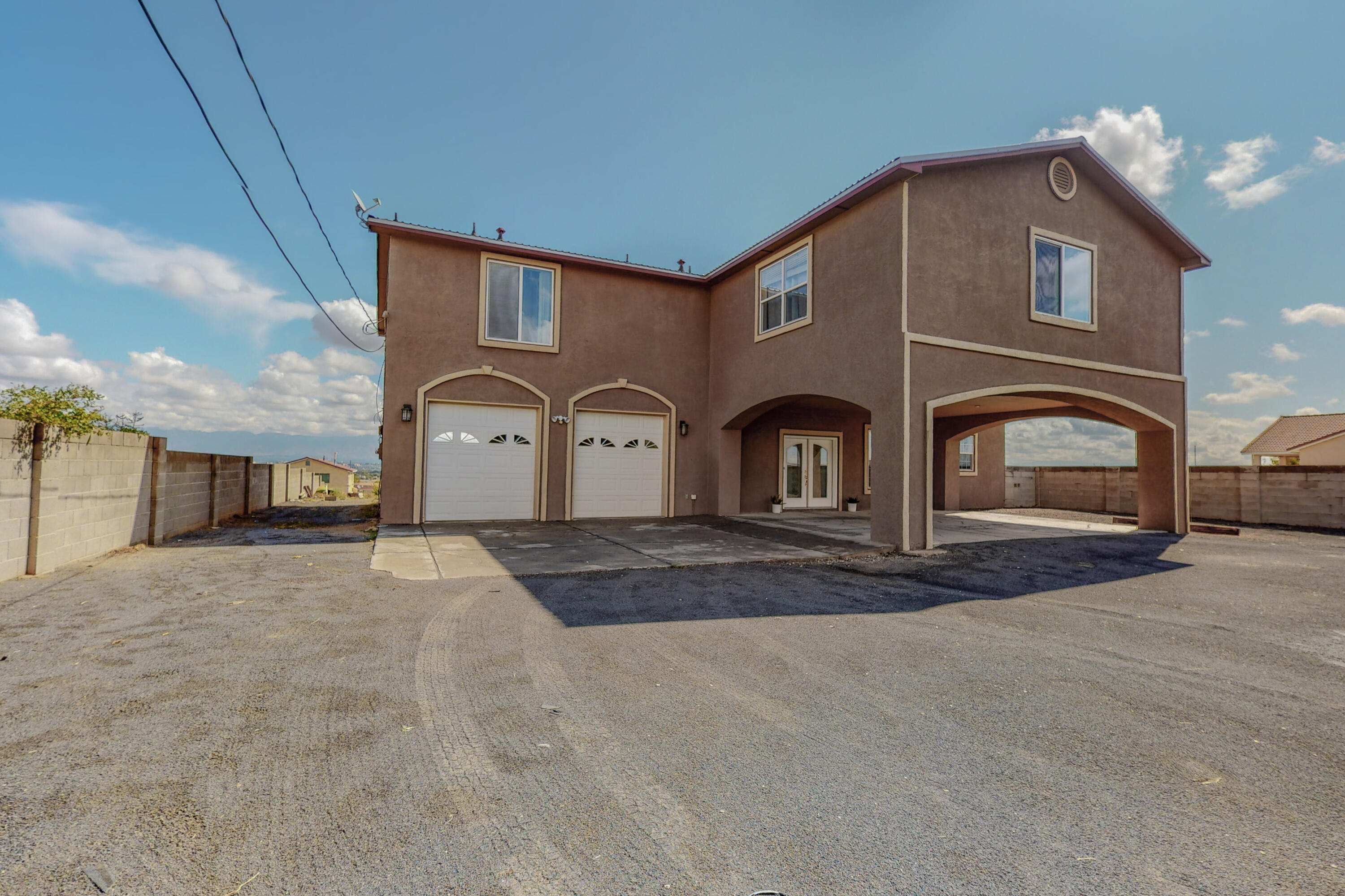 Beautiful home located in Albuquerque's Southwest Heights. HUGE two story house has many features to offer from the multiple living areas, spacious rooms, large master bedroom that includes a huge bathroom and large walk-in closet, with VIEWS. These views will take your breath away, as you can see all the sights of Albuquerque in one place from the comfort of your own home. Huge piece of land that buyers could be creative with. Garage is also another huge amenity is double sided, allowing for access from the front to the back of the house. This house is a rare find, BRING YOUR BUYERS QUICK, WILL NOT LAST LONG