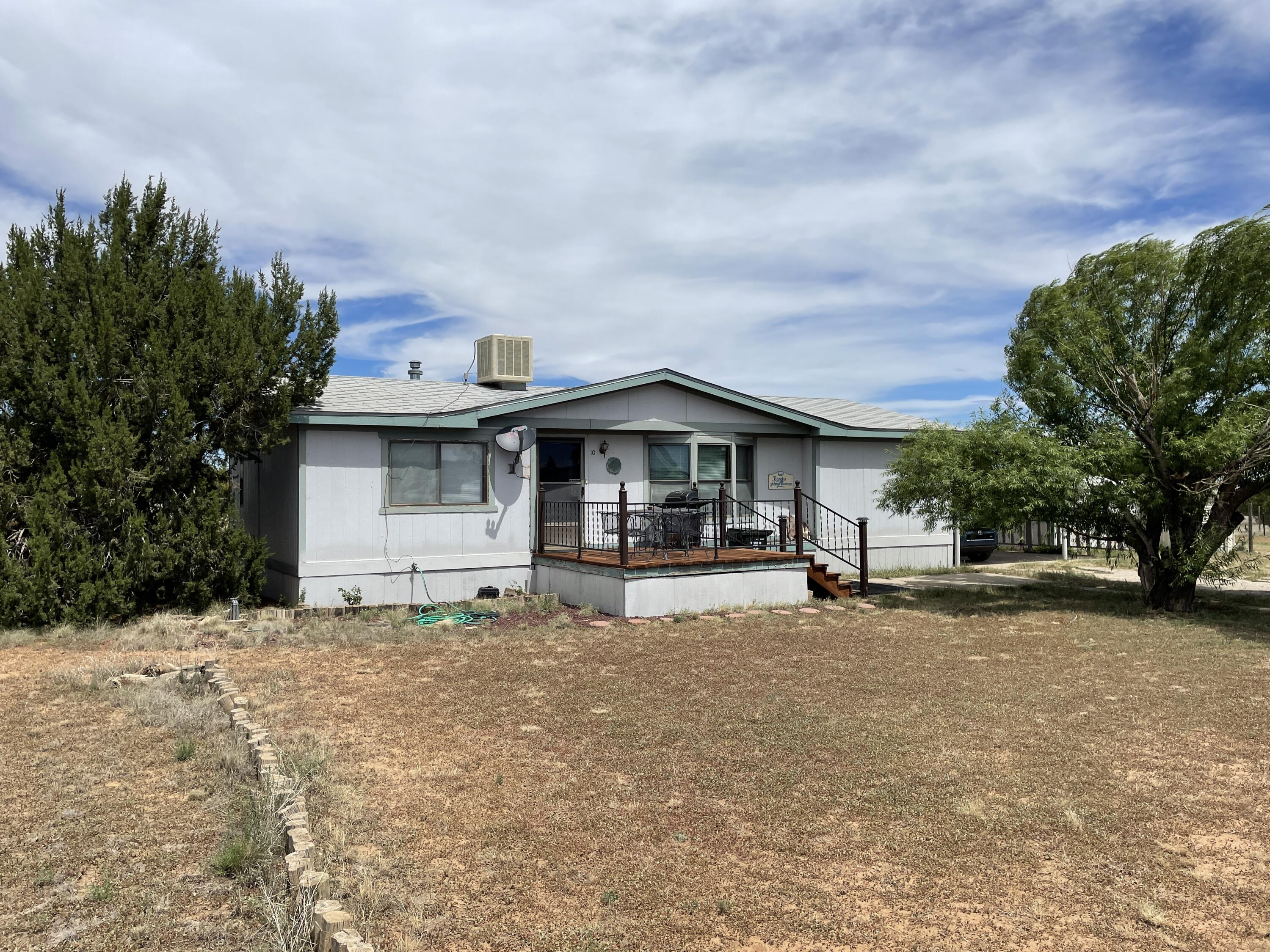 For sale nice well kept manufactured home located in Edgewood NM. Close to amenities and Moriarty Edgewood Schools. About a 35 minute drive to Albuquerque and just over an hour to Santa Fe New Mexico. This home has easy access to NM 344 and the I-40 corridor. Would be great for a single family starter home. Community water is supplied by Epcor. Includes a 24x24 covered carport and an 11x11 foot front deck. The poly piping was replaced around 1997. Owner is working on getting it on a permanent foundation. Come live the small town lifestyle.