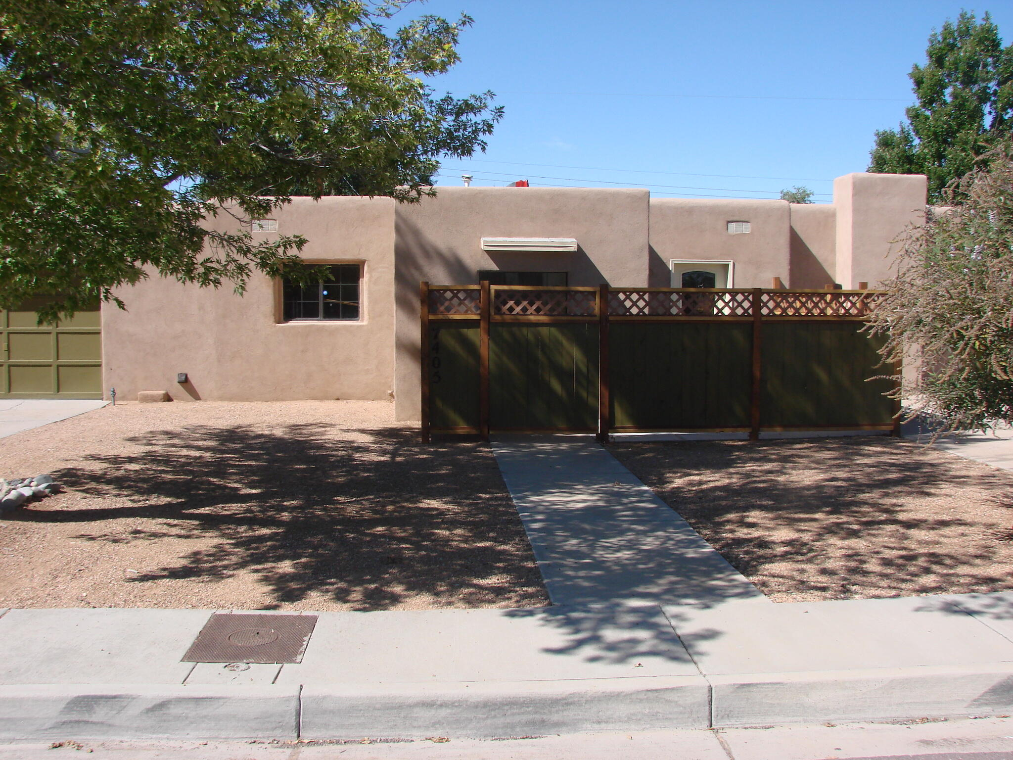 Location! Location! You will love this beautiful completely remodeled home located in a very desirable Uptown neighborhood just walking distance from Trader Joe's and ABQ uptown. Starting with the two separate driveways giving you extra room to park all your boats, trailers, toys! and the private courtyard patio entry, this three bedroom 2 bath home also features a good sized living room and a separate den with a new 9,000 BTU fireplace. Also an office or a fourth bedroom, you decide! New high quality stucco, flooring, paint, doors, appliances and fixtures throughout. A private dining area and a new Lennox refrigerated air and heating system. You are going to love living in Uptown. Take the nice feeling you get in this beautiful move in ready home and make it yours today!