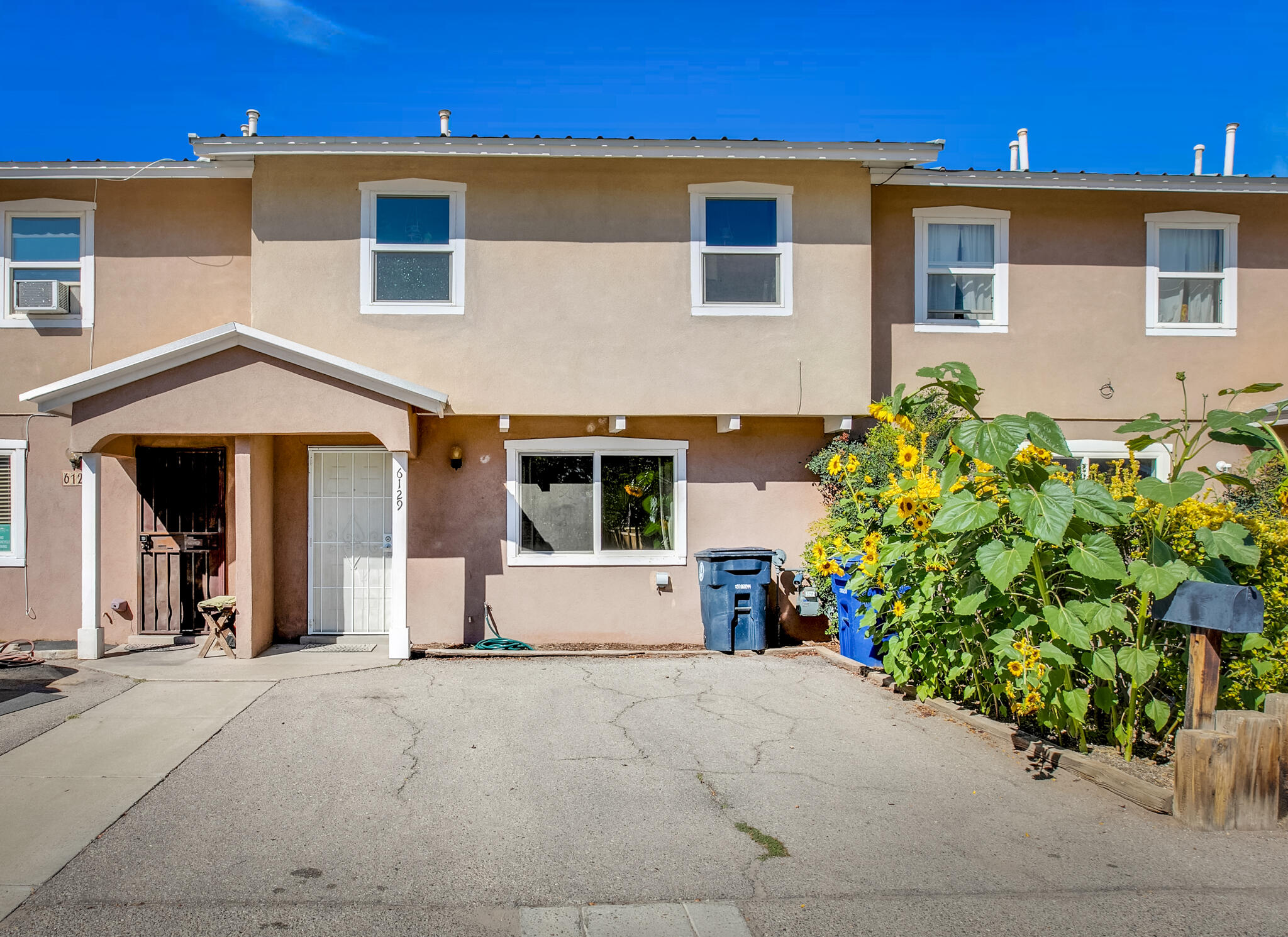 Welcome to a well loved townhome nestled within the heart of the North Valley. If you are looking for an easy to maintain home that has access to great shops, farmers markets, restaurants and freeways... this is the home for you. There is an HOA that includes the exterior of the building-fencing/stucco/roof and shaded common areas with grass. There are many recent upgrades to the property; Evaporative cooler, bathroom vanity, fresh paint, 220v exterior electric plug in for a vehicle, and a new dishwasher. This property will not be on the market long, don't wait to view this one!!