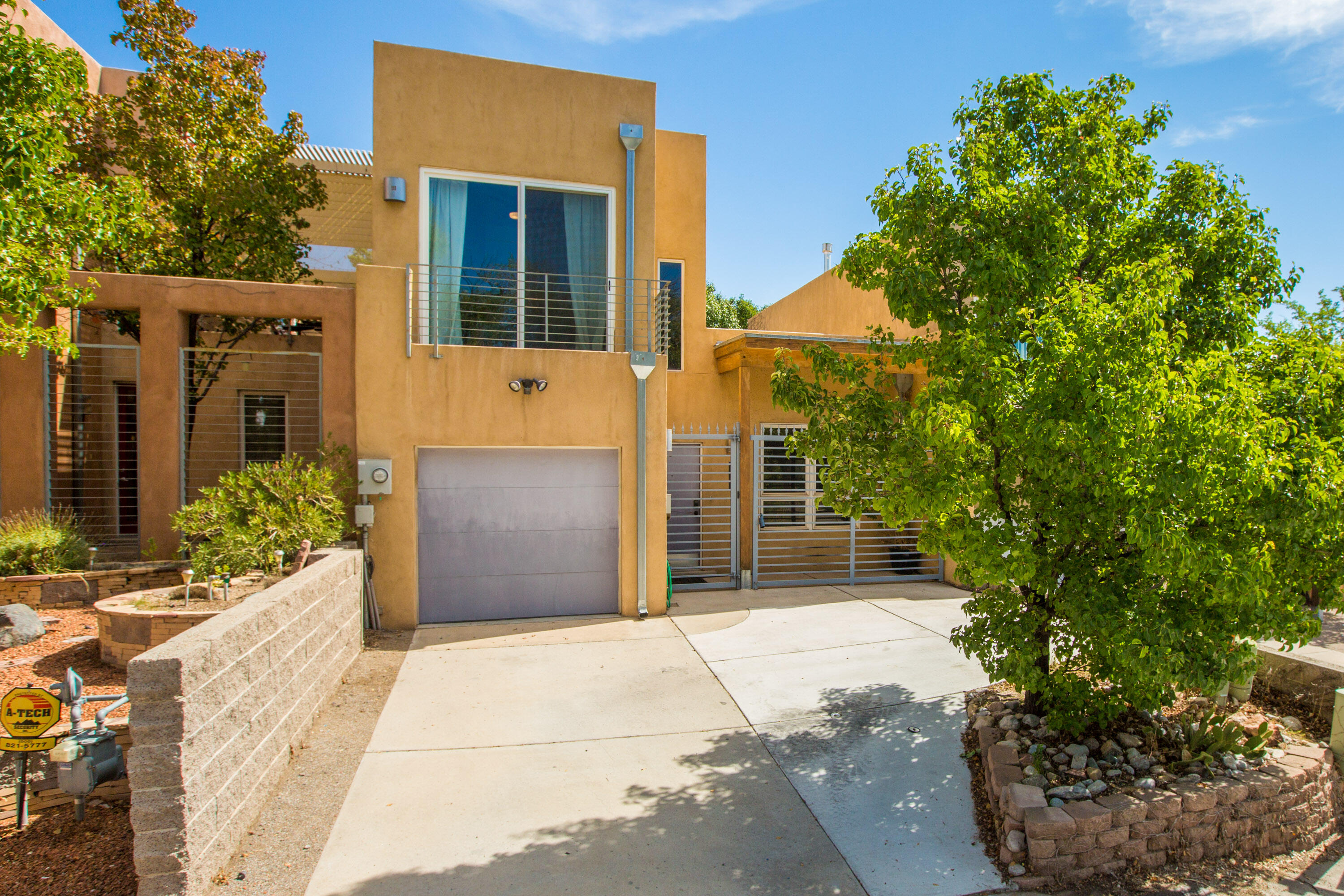 Well maintained Spruce Park townhome located in a highly desirable neighborhood close to UNM, Hospitals and Downtown with close access to bike trails, the freeway and the Rail Runner. This townhome features 3 bedrooms, 2 full bath, open living and dining with a 2 way indoor/outdoor fireplace perfect for outdoor entertaining on the backyard covered patio. The primary bedroom is located on the first floor with sliding glass doors leading to the private backyard. East and West facing balconies provide views from the second level bedrooms. Recent upgrades include a new radiant heat system, 2 new coolers, new TPO roof and newer paint. No HOA fees. Contact your broker for a showing!