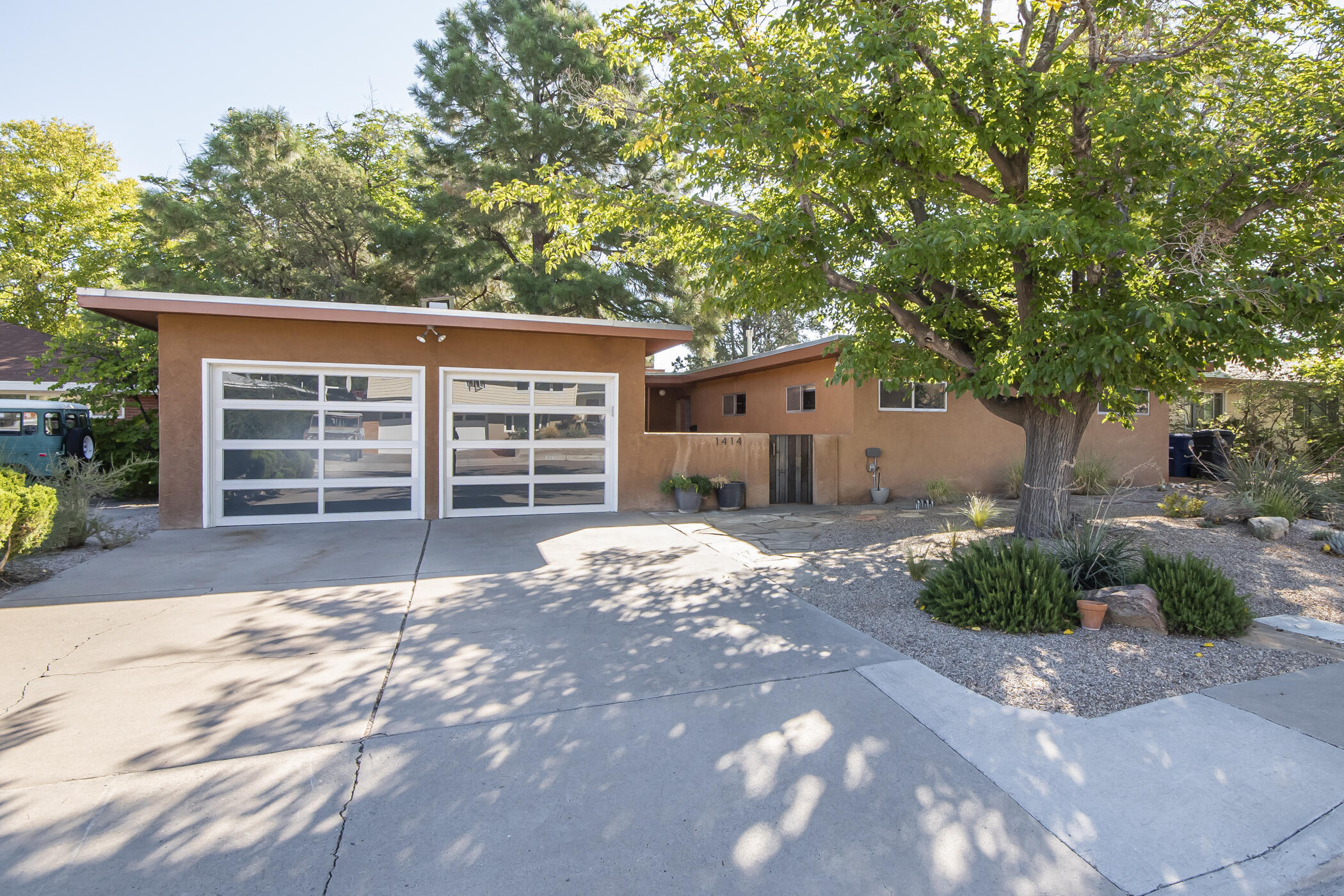 Renovated mid-century home offers contemporary updates, a light-filled open floorplan and amazing outdoor spaces in a centrally located UNM neighborhood. Chef's kitchen with a large center island, quartz counters, ample cabinetry, wine cooler and stainless appliances. Wall of windows and double sided fireplace in greatroom plus second living area with built-ins. Both living spaces open to a private backyard retreat with mature landscaping, raised beds, bocce court and plenty of patio space with views of the Sandias! Insulated garage with glass doors and mini-split doubles as studio/workout/flex space not included in sqft. Remodeled bathrooms, seller owner solar panels, Rachio automated irrigation system, newer washer, dryer and cooler. Convenient to 1-40, Whole Foods, Altura & Summit Park.