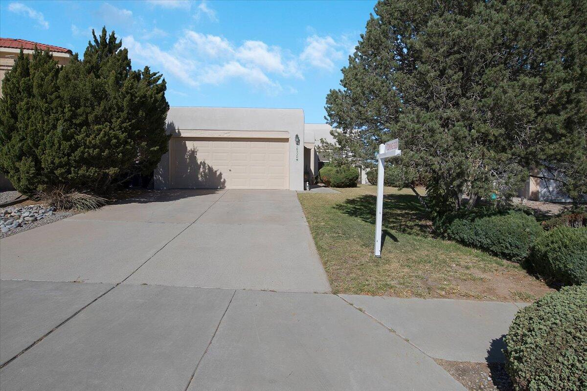 SW Style One Owner home on large .27 acre lot. 3 Bedroom, 2 Bath, 2 Car garage. Great Room w 12 ft ceilings, viga beams and tongue and groove. Recent TPO Roof, Synthetic Stucco, Water Heater, and Furnace.  Large yard includes jacuzzi spa and pergola. Front and rear lawn w/ low maintenance mature landscaping, underground sprinklers. BBQ connected to natural gas stays. Close to shopping, schools, easy commute to east side. Don't delay this home won't last long.