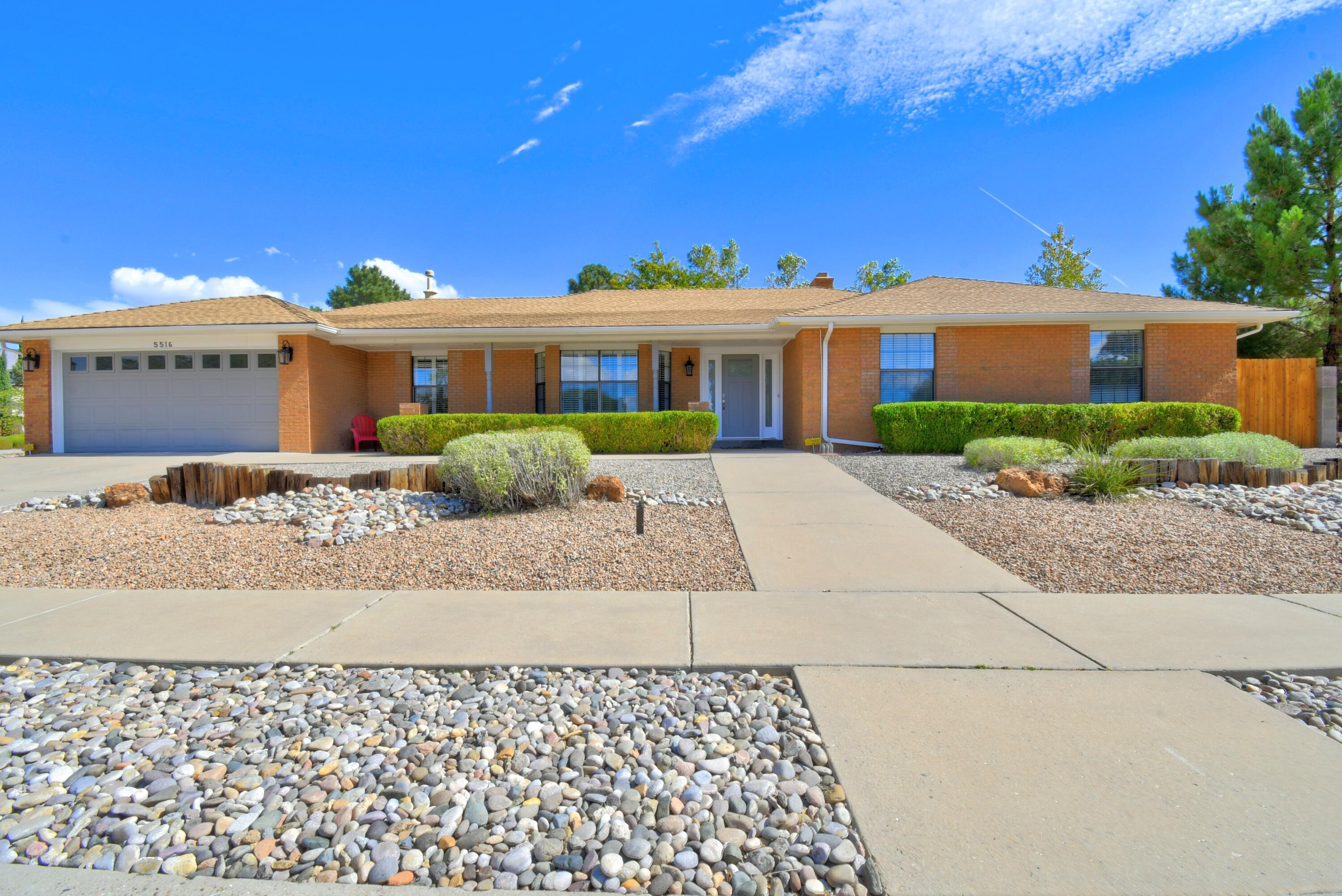 Awesome remodeled home situated on a large corner lot in Academy Estates. La Cueva HS district. Single story, brick, 4-BR & 3-BA. Mother-In-law bedroom w/it's own 3/4 bath. Flowing floorplan, kitchen is open to the family room that wraps around to the formal living/dining room. Large owner's suite w/split vanities & 2 walk-in closets.  Recent updates: Wood look tile throughout, updated kitchen and baths, tile backsplash, baseboards, stacked  stone fireplace, Granite counters in kitchen & vanities, fresh paint, hardware & light fixtures, entry door, hot water heater, cedar fence & so much more. Easy care front yard w/ drip system. Backyard features lush grass, fruit trees & large gardening area, covered patio w/views of the Sandias, & backyard access for RV.