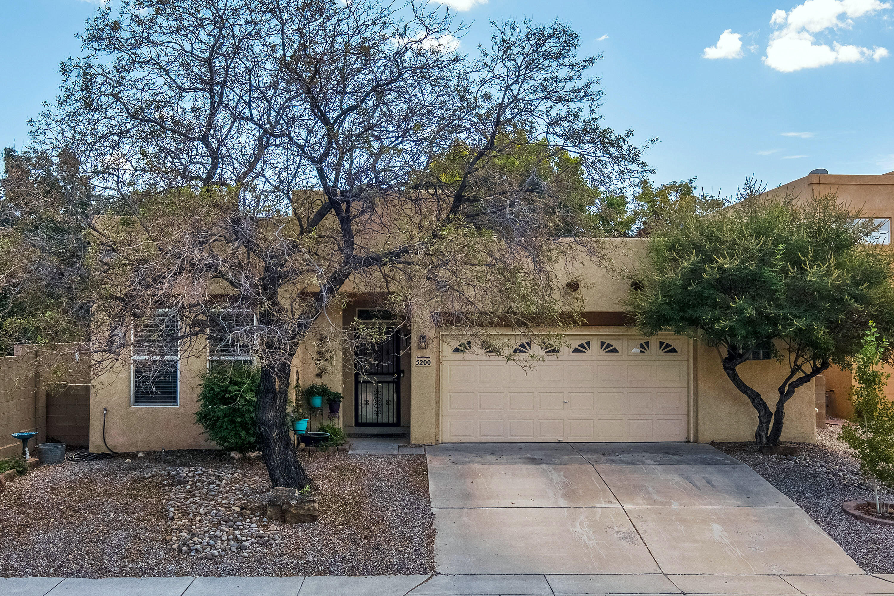 Gorgeous and Inviting! Single Story 3 Br 2 Ba 2 car with extra space for a workshop. Refrigerated air, stunning hardwood flooring, Tile in wet areas, carpet in the minor bedrooms. Open floor plan, high ceilings with no wasted space. Custom Kiva Fireplace with log lighter. Wonder kitchen with double ovens, gas cooktop and high counter with room for 5+ bar stools.  The owner's suite offers a large walk in closet, wood flooring and many elegant touches like dual sinks, garden tub and separate shower with fantastic tile work. The backyard will draw you in and the large covered patio with hot tub will make you want to stay. This home checks a lot of boxes and once you see it you'll know it won't last long.