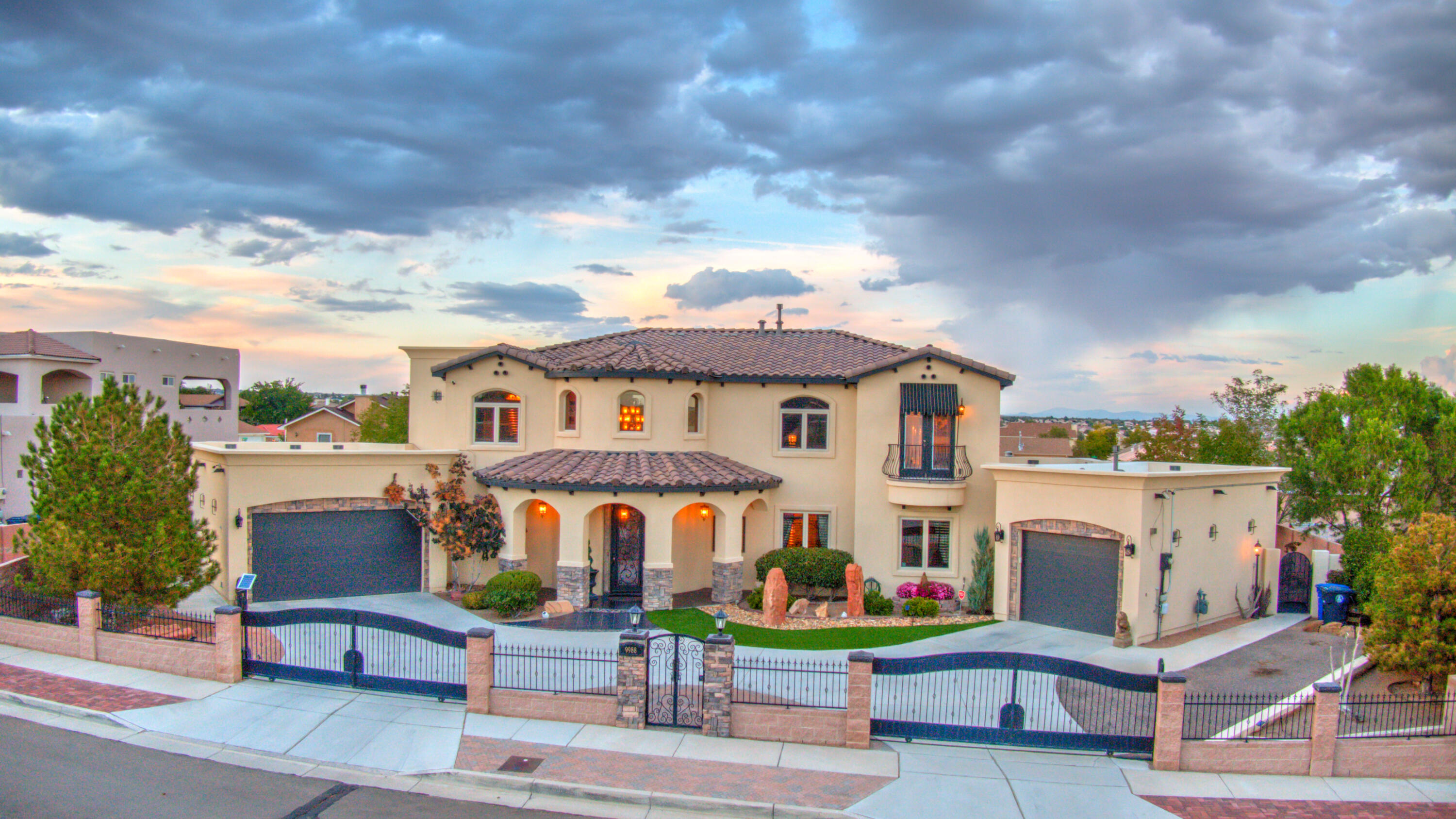 Custom Tuscan Style home by Sandia Builders has it ALL!  Two lots w/Side Yard Access. Two Owners Suites/In-Law Suite. Main Upstairs & In-Law down w/Side Entrance off Single Car Garage. Open Concept w/Dining Room, Large Living room, and Kitchen w/Breakfast Nook. Chefs Kitchen w/Gas Cooktop and Butler Pantry! All Custom Cabinets w/Granite Countertops and New Island. New Billiards/Entertaining Room opens to Backyard w/Outdoor Kitchen, Covered Patio, Fireplace, and Bball hoop. Upstairs has Loft  and 2 additional Bedrooms one w/Balcony facing Northeast catching view of the Sandias! Gated driveway w/west gate on automatic opener.  Plastered accent walls w/hand painted fireplace, pillars, accent ceilings, owners suite bathroom, and nichos.  Floating staircase in entry way and TOO much to list...
